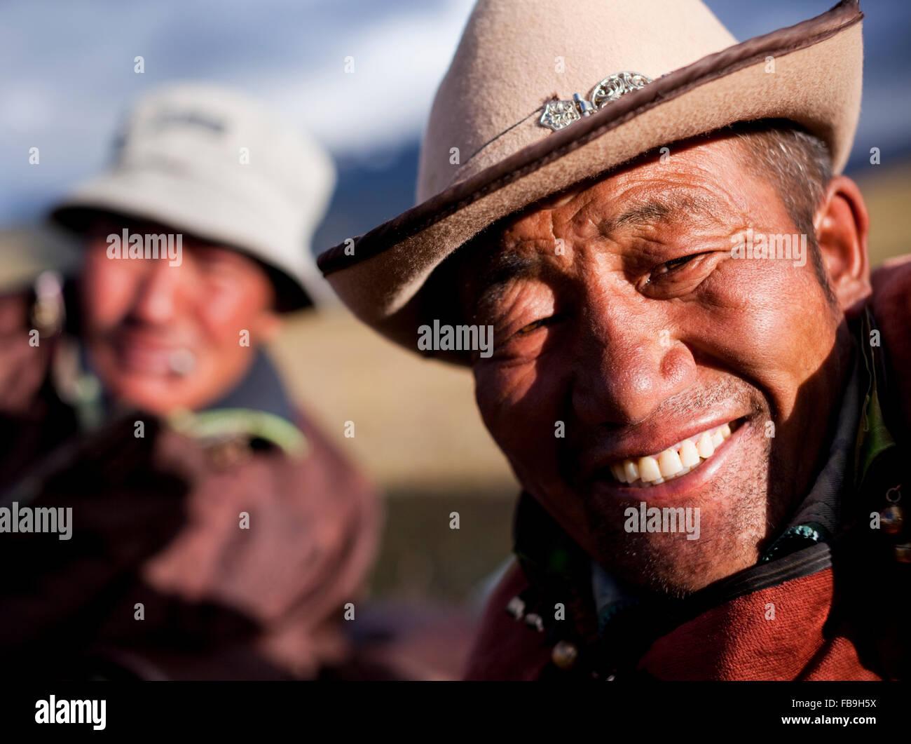 Idesh, l'uomo con i milioni di dollari di sorriso, un locale herder e guida in Kharkhiraa Turgen National Park, Immagini Stock