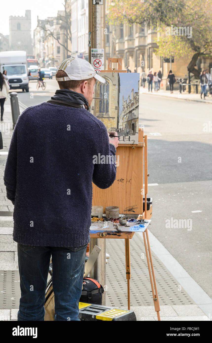 Un artista Pittura Plein Air in High Street, Oxford, Inghilterra, Regno Unito. Foto Stock