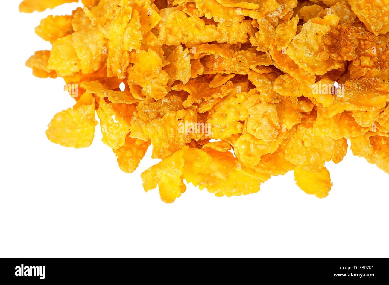 Parte pila di fiocchi di mais isolati su sfondo bianco Immagini Stock
