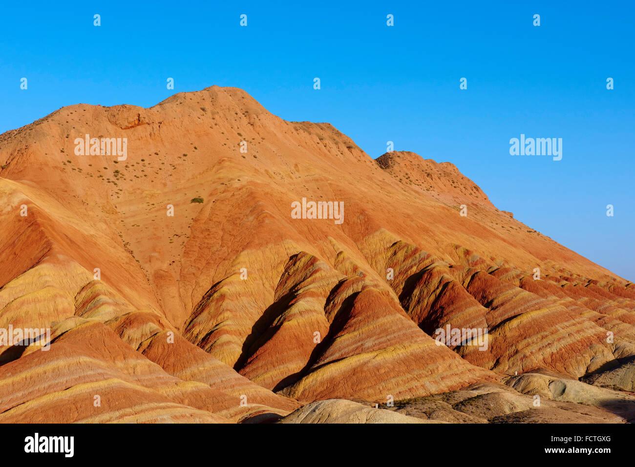 Cina, provincia di Gansu, colorato Danxia rilievi in Zhangye, Patrimonio Mondiale dell Unesco Immagini Stock