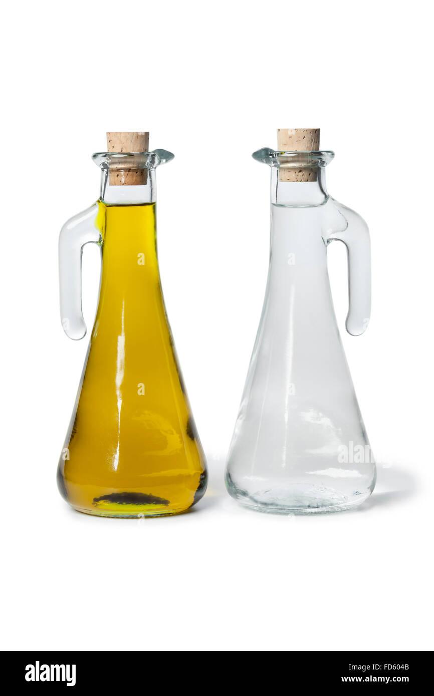 Coppia di olio e aceto bottiglie su sfondo bianco Immagini Stock