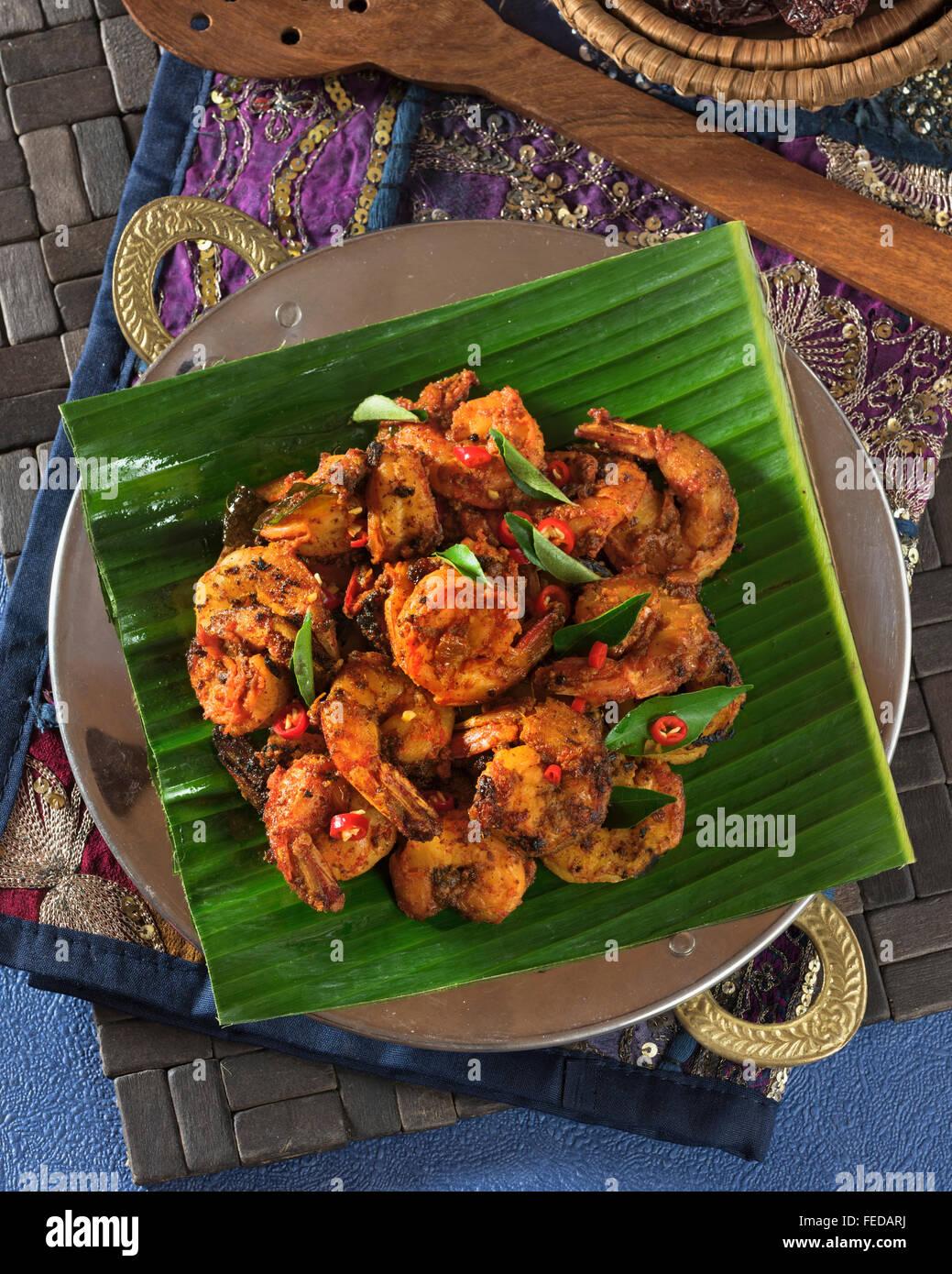 Tawa gamberi. Fritti speziati masala gamberi. India cibo Immagini Stock