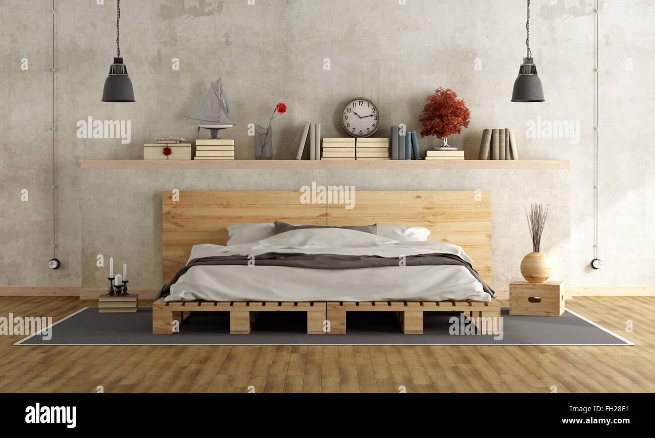 Camera da letto con un muro di cemento pallett, letto e gli ...