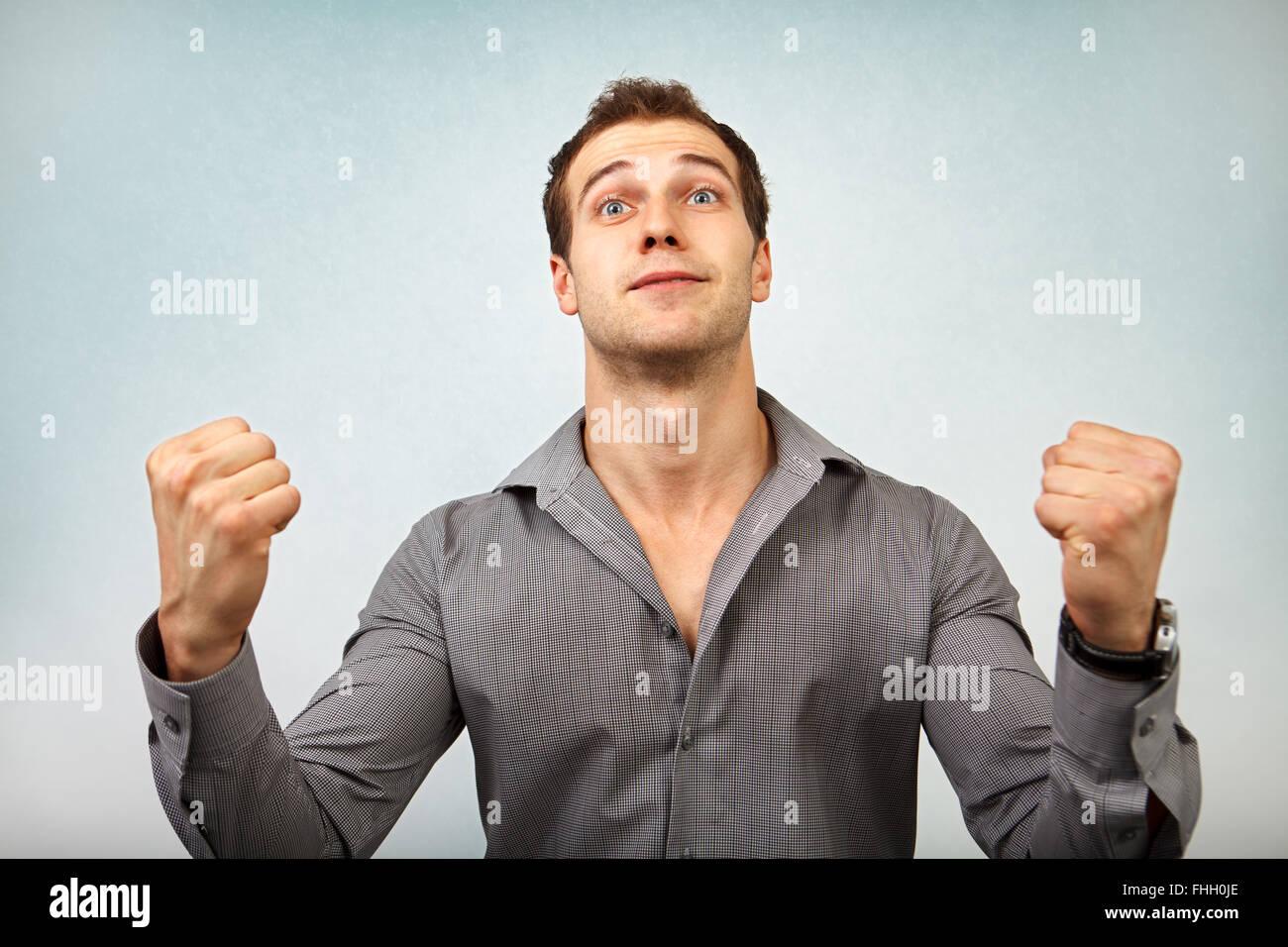 Felice l'uomo vincente isolato su bianco Immagini Stock