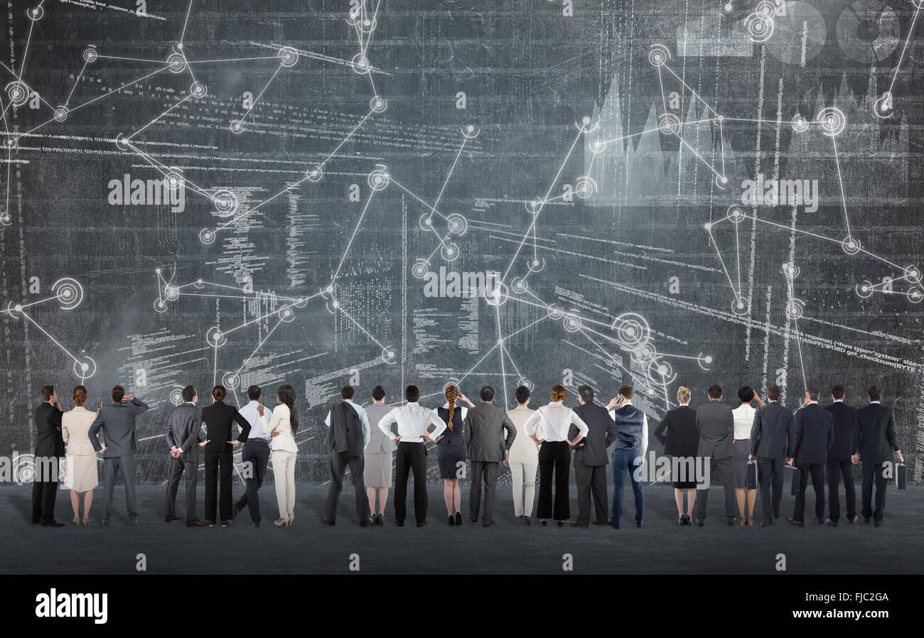 Immagine composita della vista posteriore del business multietnica di persone in piedi a fianco a fianco Immagini Stock