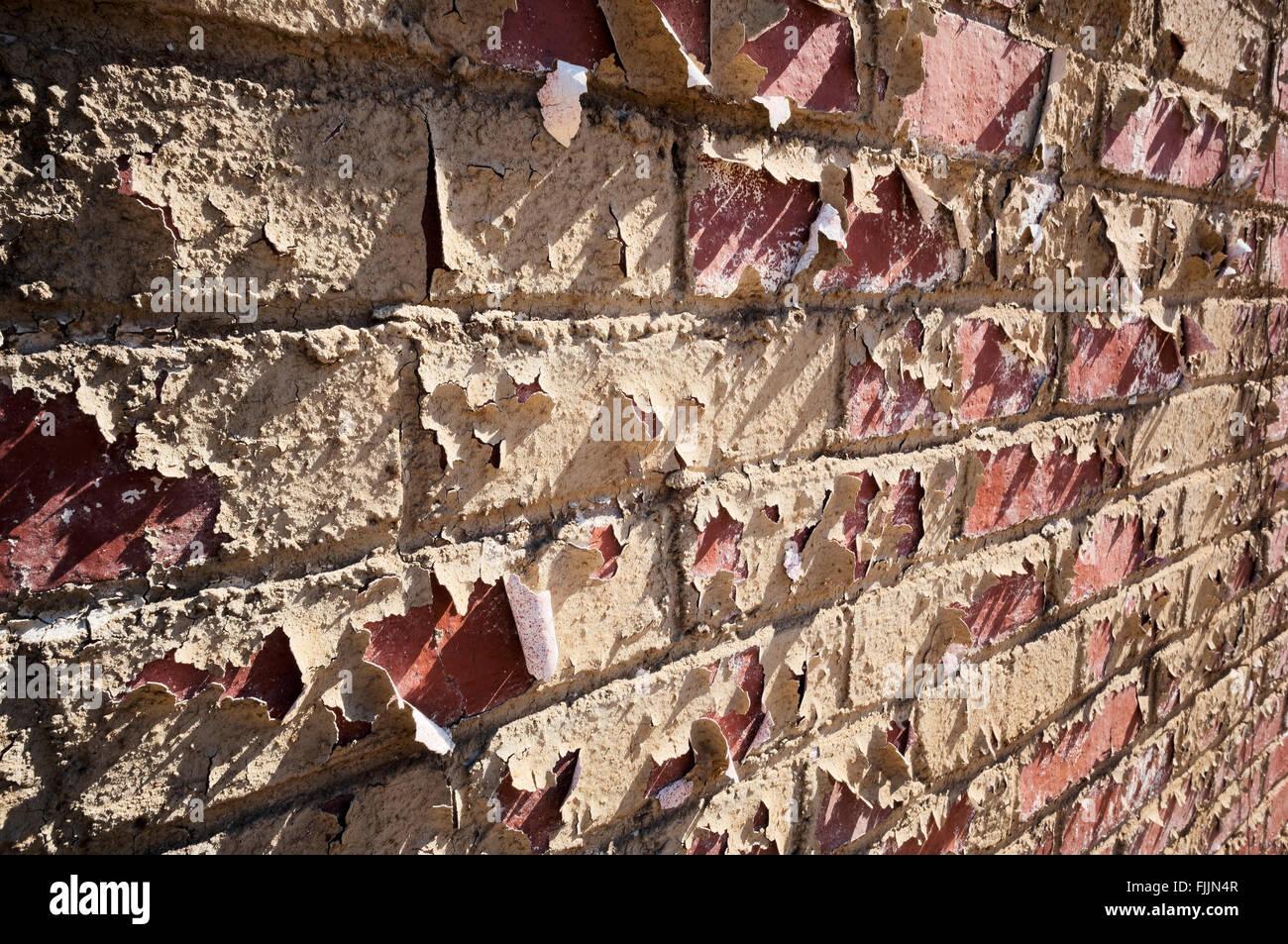 La pelatura della vernice sul mattone Immagini Stock