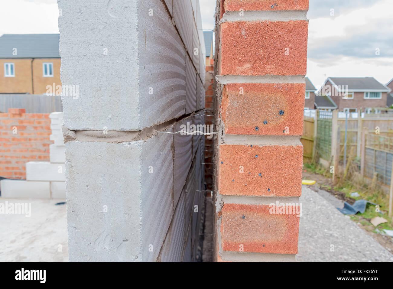 incontrare qualità autentica catturare Casa in varie fasi di costruzione mostra parete metallica ...