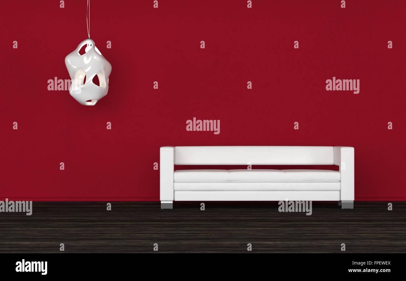 Confortevole divano bianco in una sala rossa in piedi contro la