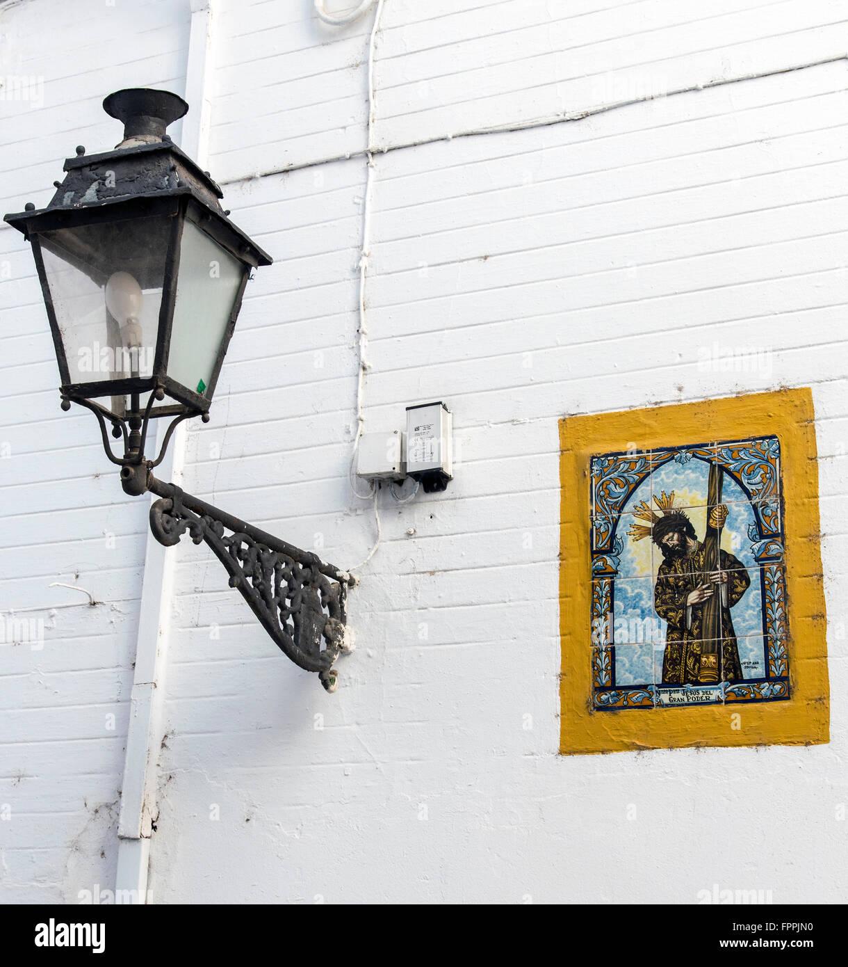 Icona religiosa piastrella l opera di Gesù Cristo in una strada di Siviglia, in Andalusia, Spagna Immagini Stock