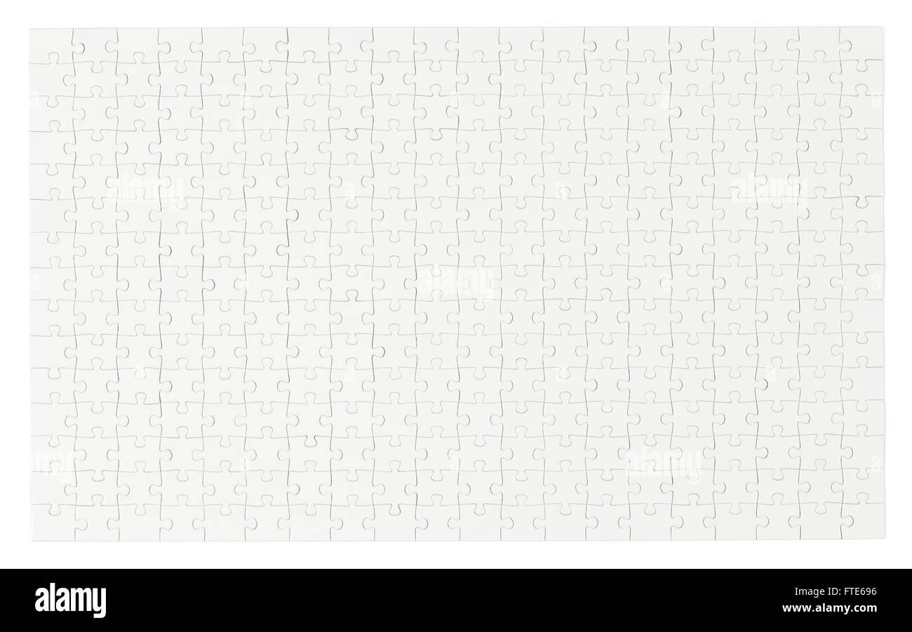 Tutto bianco completa Puzzle con copia spazio isolato su sfondo bianco. Immagini Stock