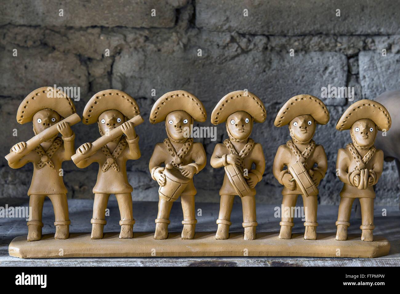 Bonecos de barro representando una banda de Pifanos de Caruaru - artesao Severino Vitalino Immagini Stock