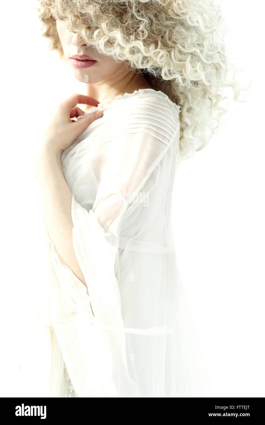 Curly donna bionda Immagini Stock