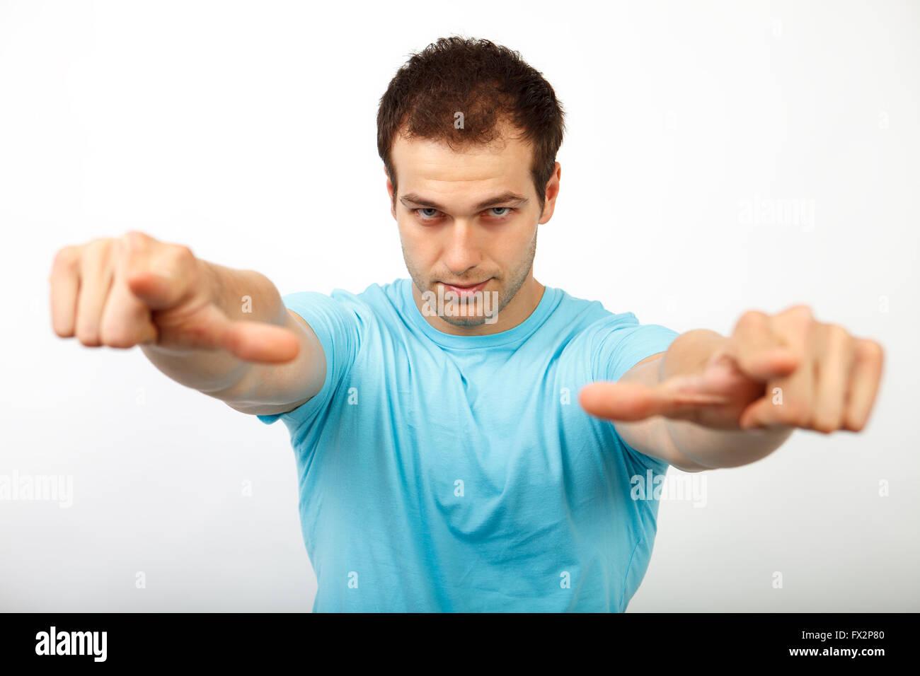 Scelta o concetto di prelievo - cool giovane uomo rivolto verso di te Immagini Stock