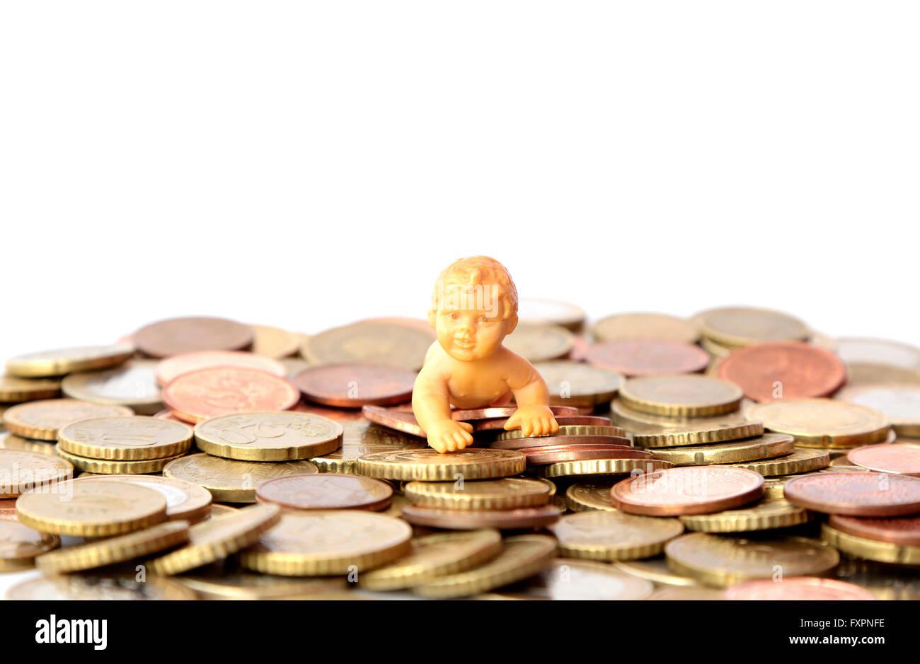 Un bambino su un mucchio di soldi Immagini Stock