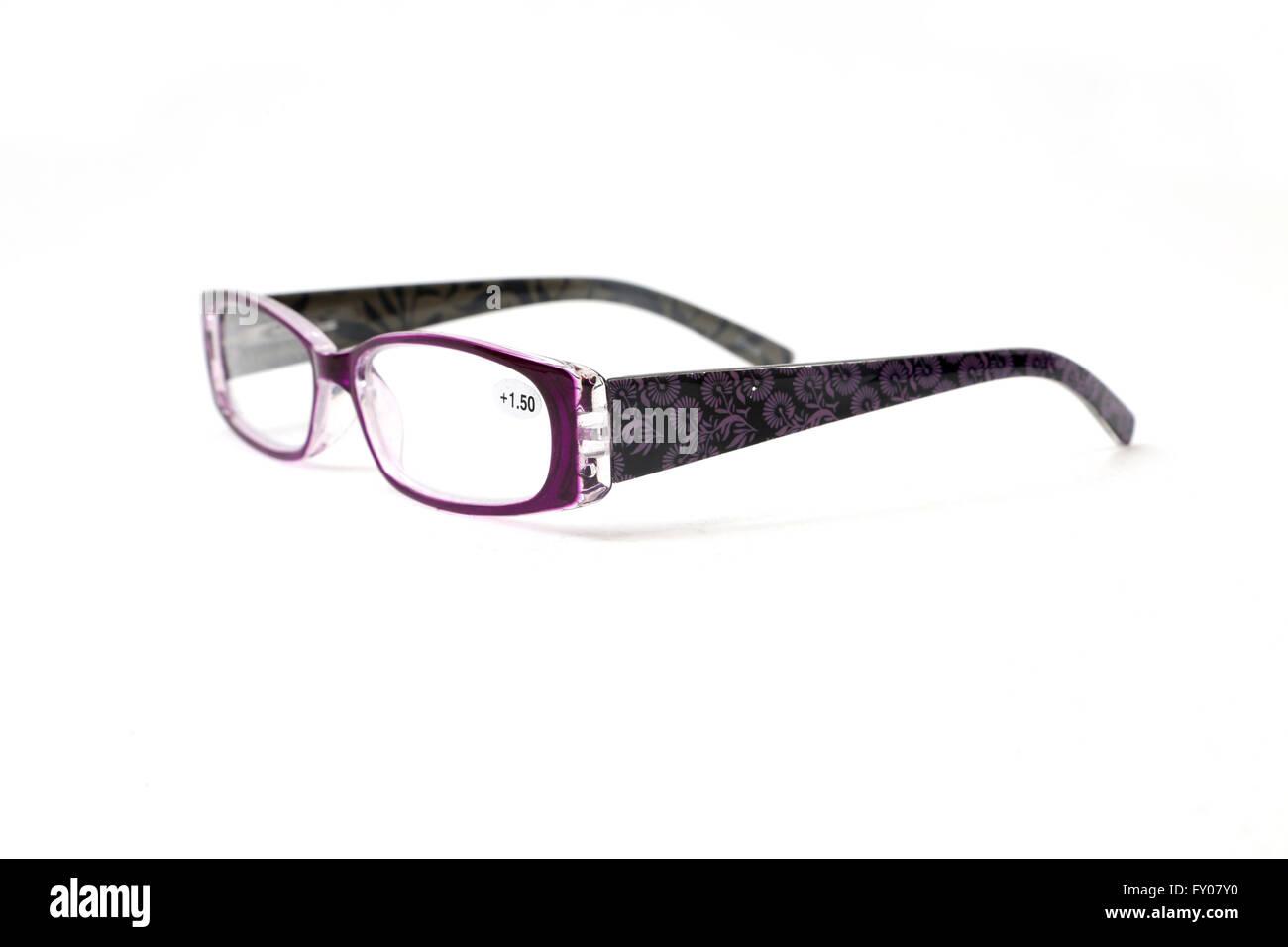 Viola gli occhiali da lettura con motivo floreale su bracci Immagini Stock