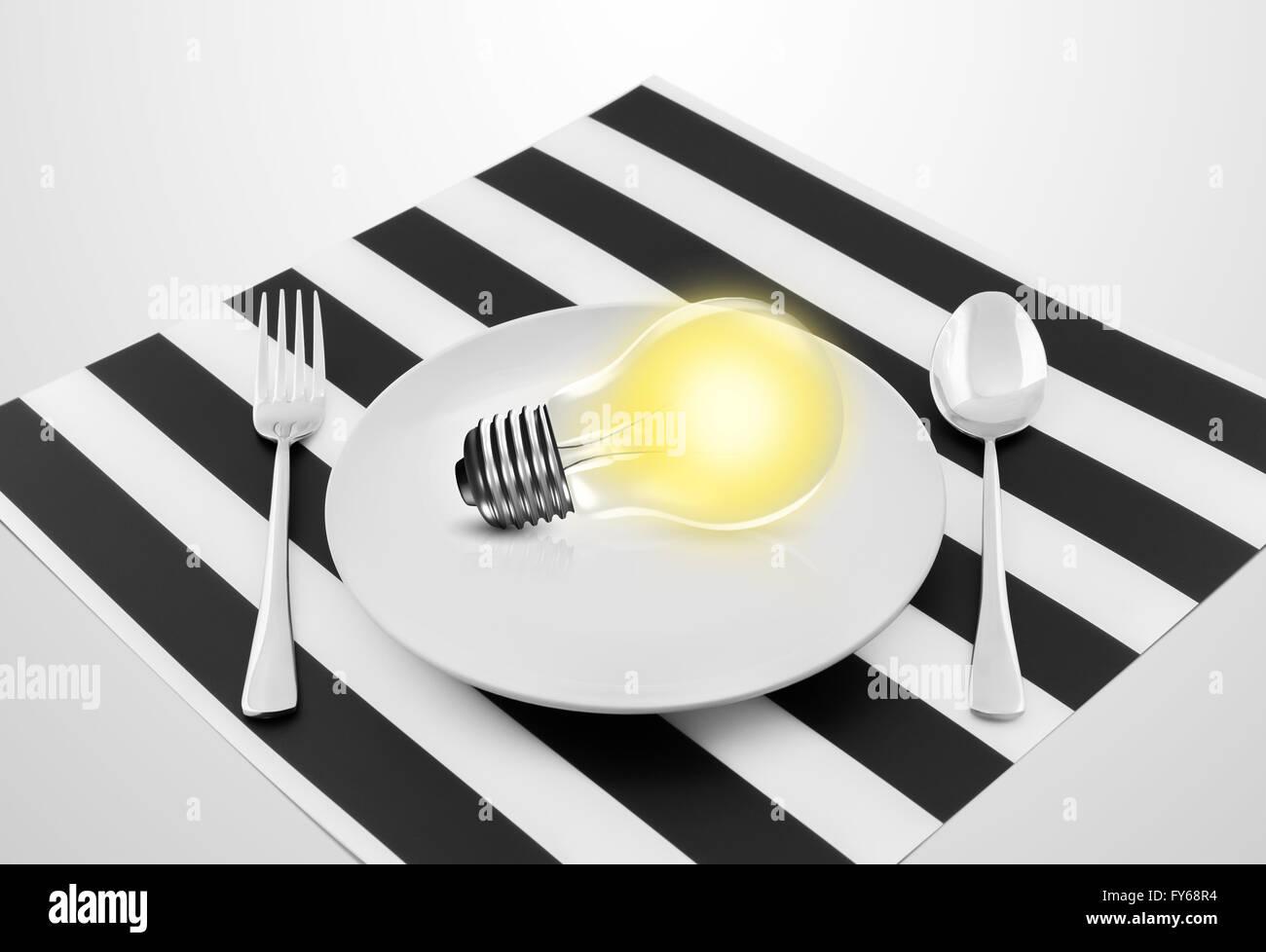 Lampada nella piastra e cucchiaio e forchetta, serve un'idea concept Immagini Stock
