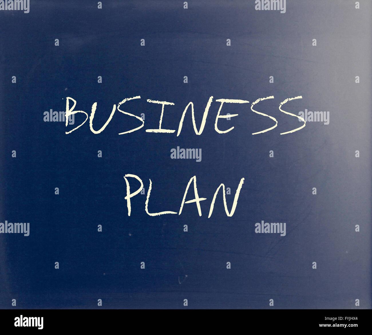 Business plan scritta a mano con il bianco gesso su una lavagna Immagini Stock