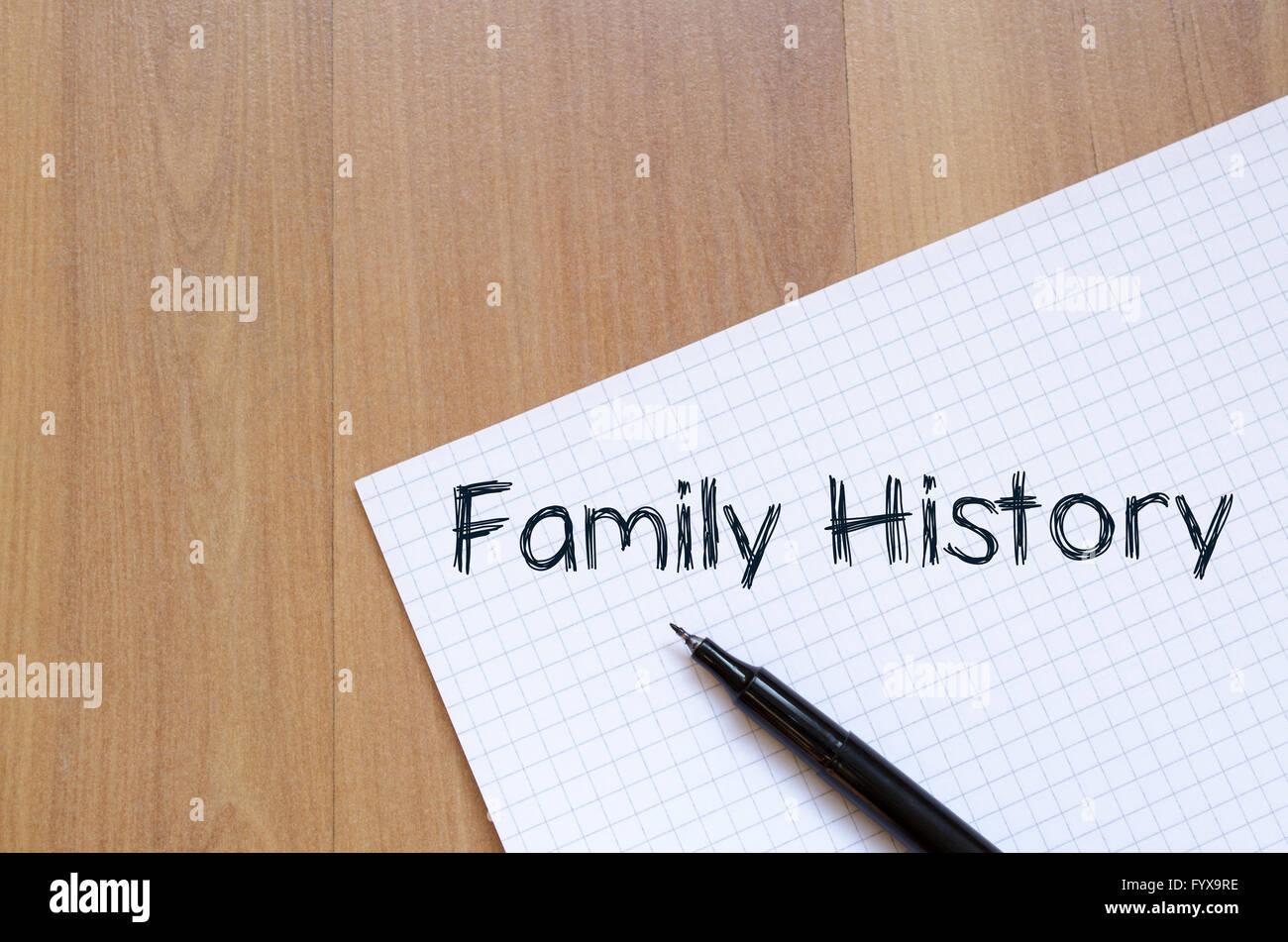Storia di famiglia scrivere su notebook Immagini Stock