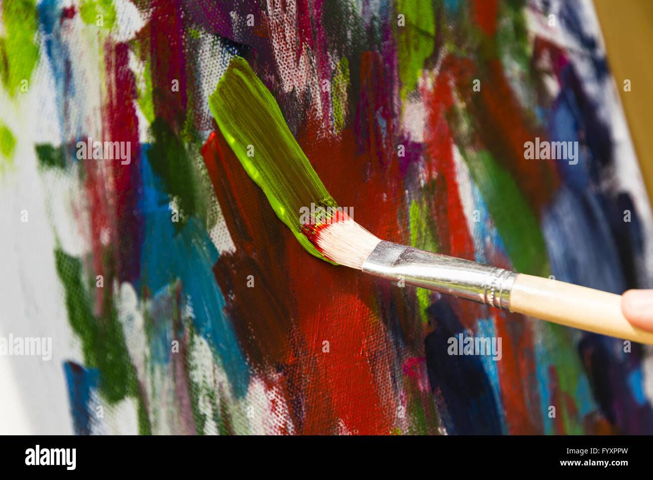Dipingere con colori acrilici Immagini Stock