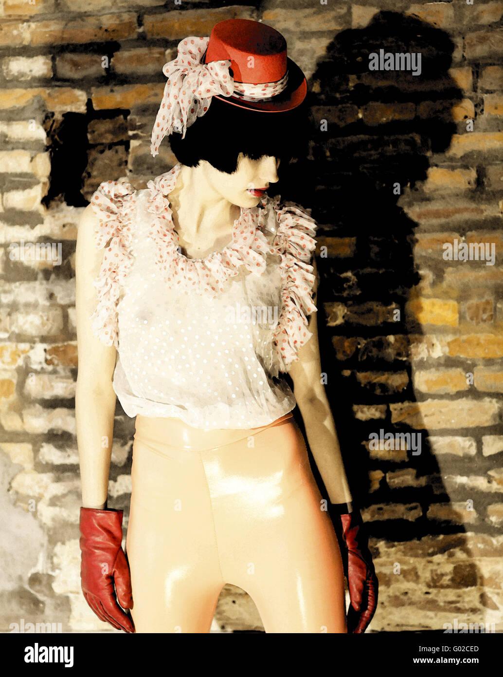 Giovane donna con labbra rosse,guanti e hat Immagini Stock