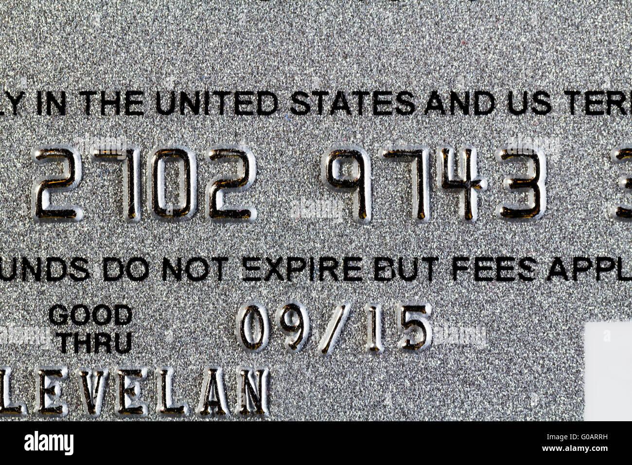 Girato a tenuta frontale del dono carta di debito Immagini Stock