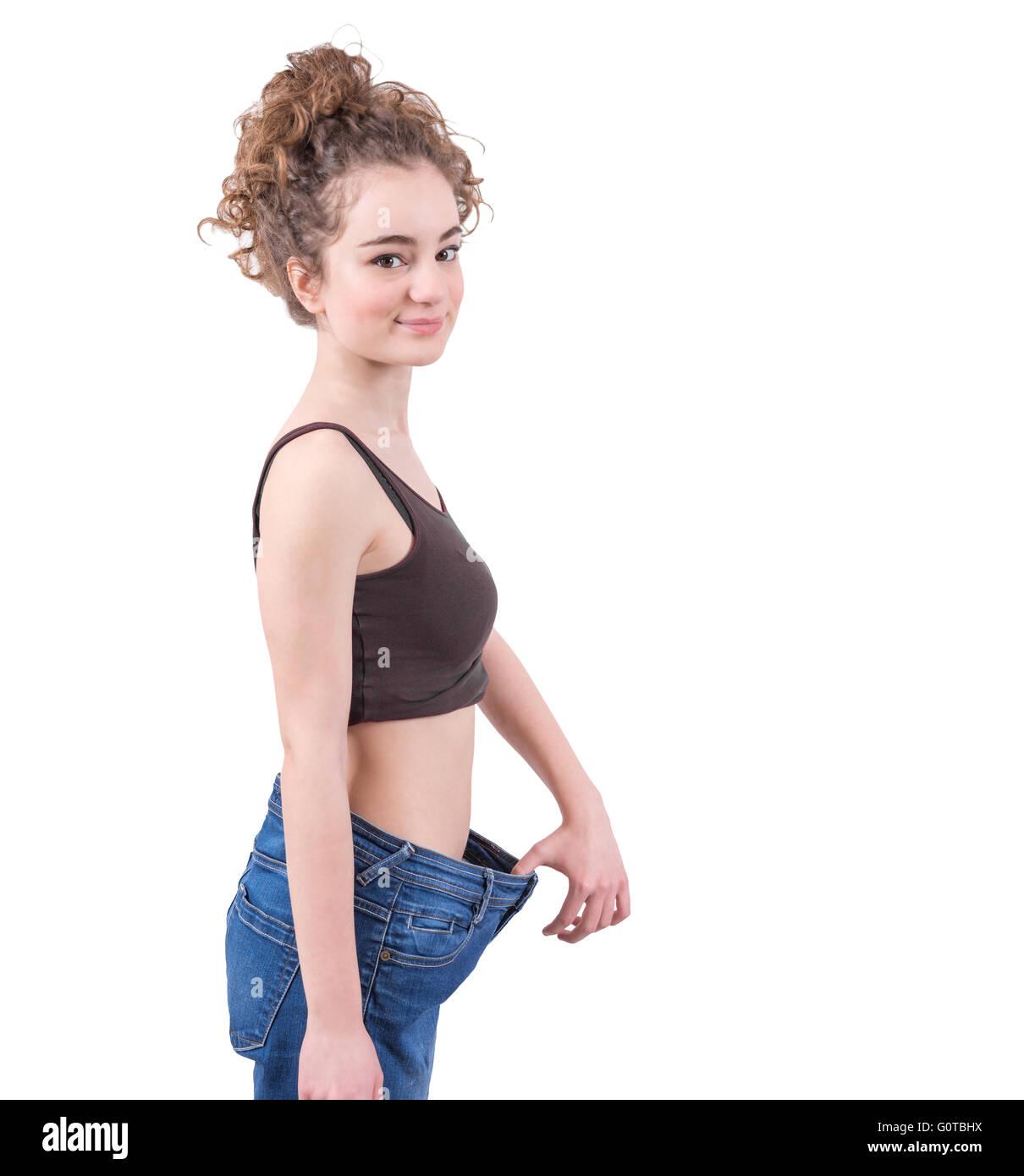 Molto skinny girl indossando larghi pantaloni jeans Foto
