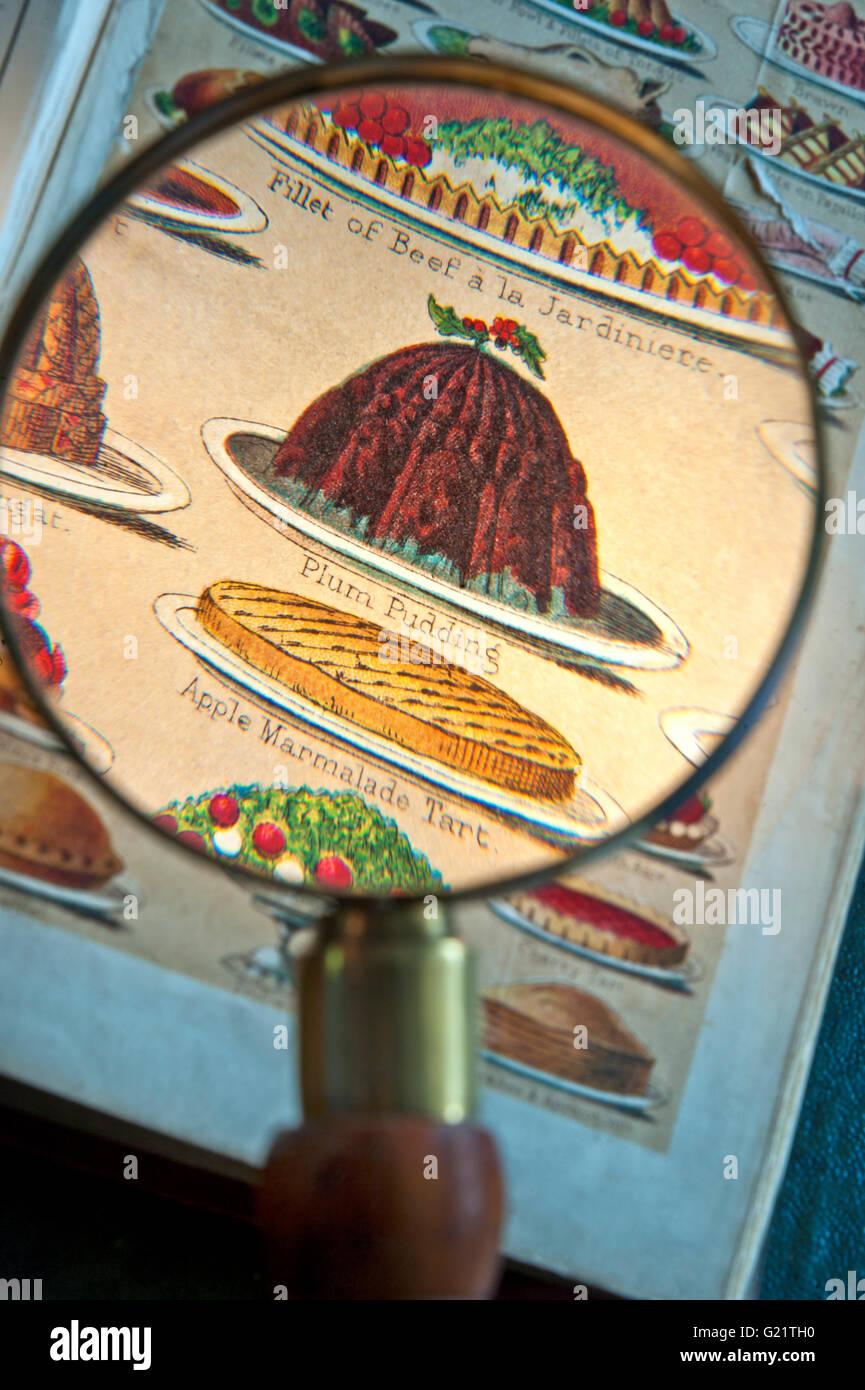 PUDDING natalizio lente di ingrandimento su Mrs Beeton del libro di cucina che illustra i piatti in stile vittoriano Immagini Stock
