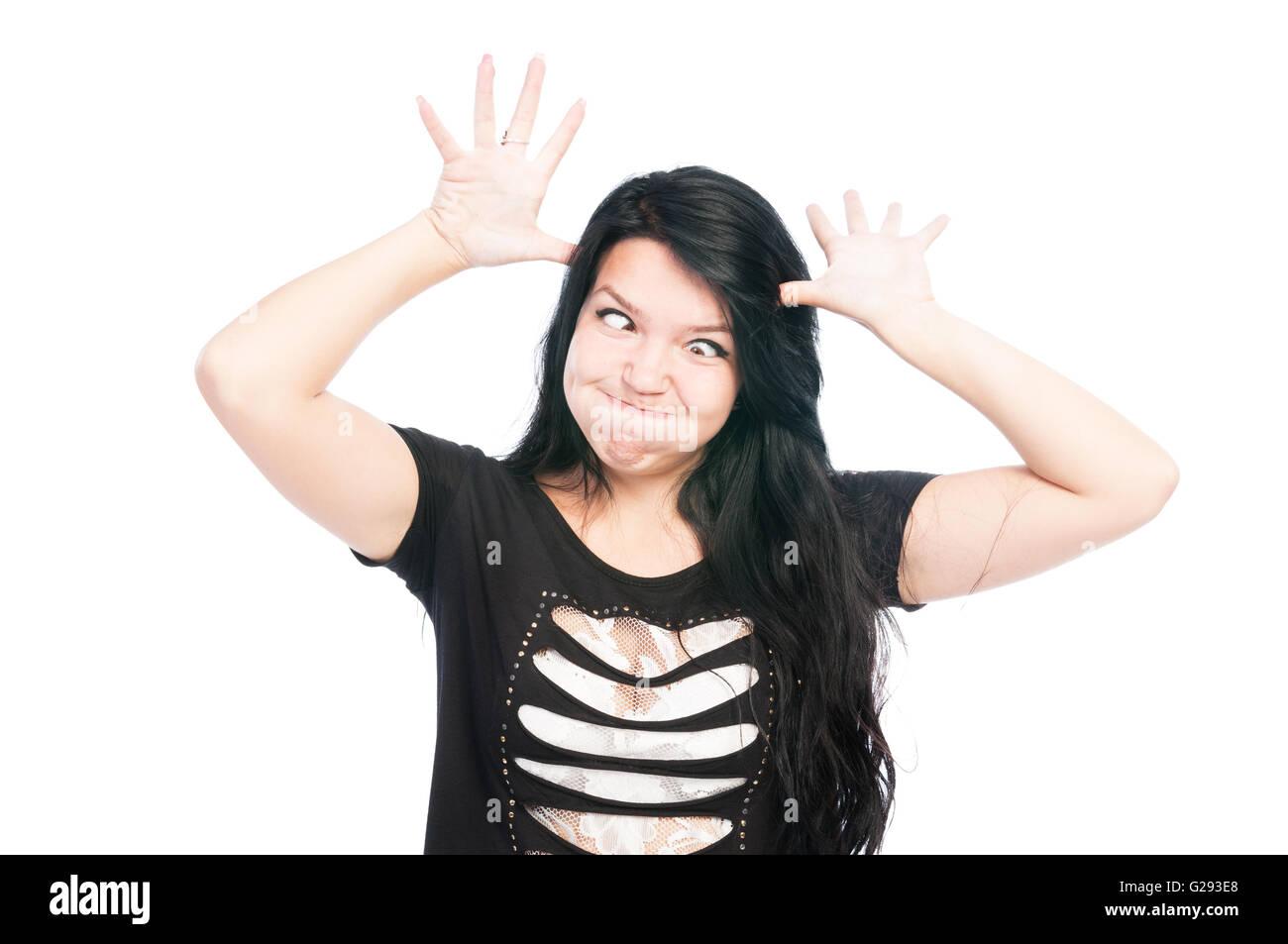 Teen girl rendere divertente faccia con occhi incrociati Immagini Stock