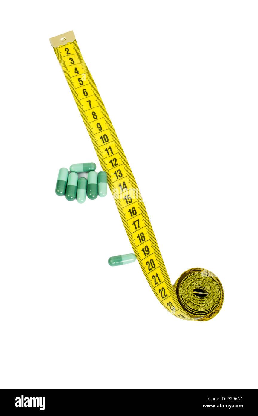 Antiossidante o a base di erbe naturali, diet pills concetto con capsule di verde e misuratore Immagini Stock