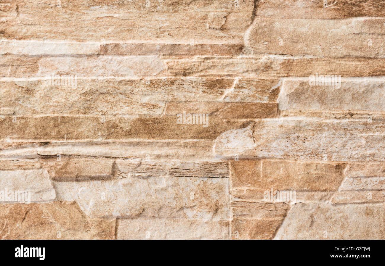 Si tratta di un pavimento di piastrelle con un muro di pietra