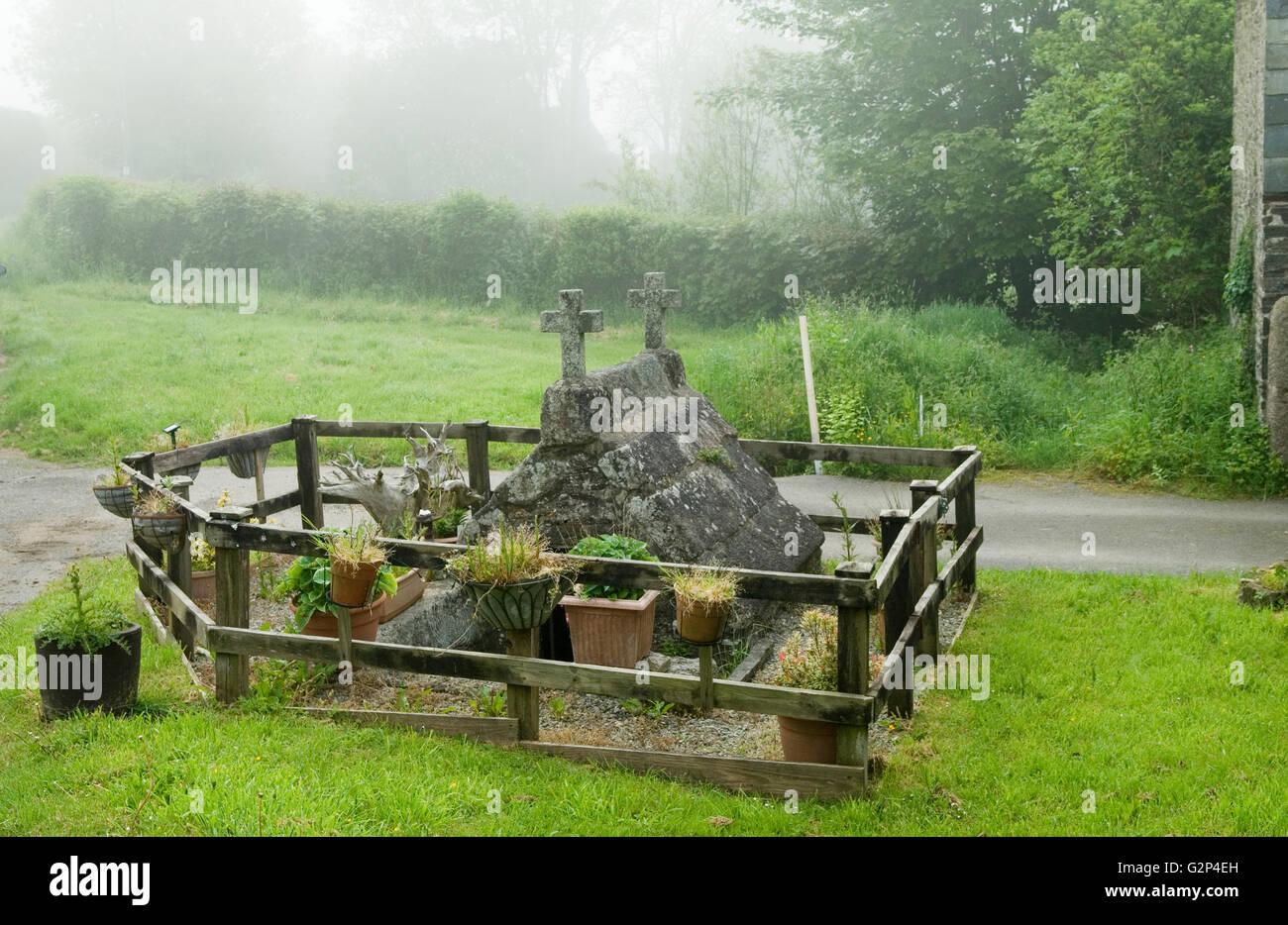 Pozzo santo Cornwall Rezare HOMER SYKES Foto Stock