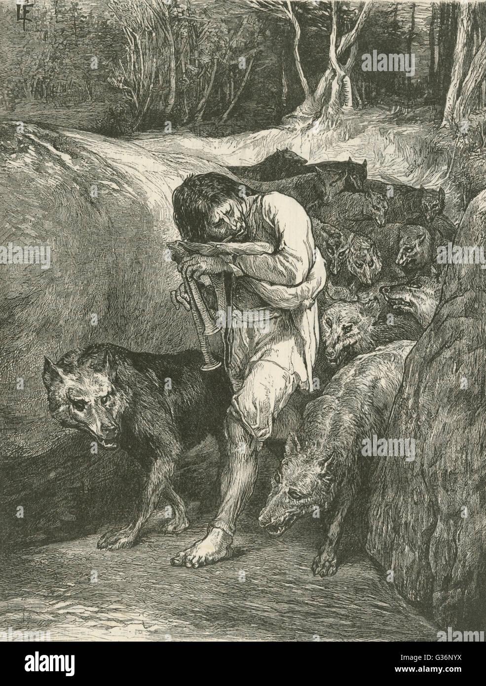 Il Wolf-Charmer -- le meneur de loups -- un folklore figura rurale della Francia che è in grado di domare e Immagini Stock