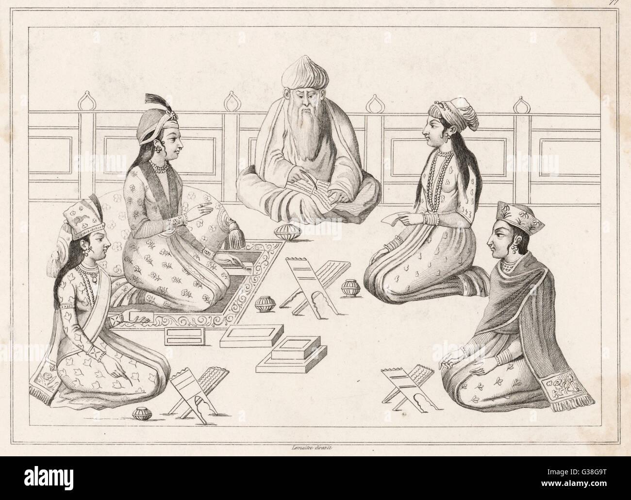 Un religioso sage fornisce istruzioni di quattro studenti, probabilmente alla corte reale. Immagini Stock