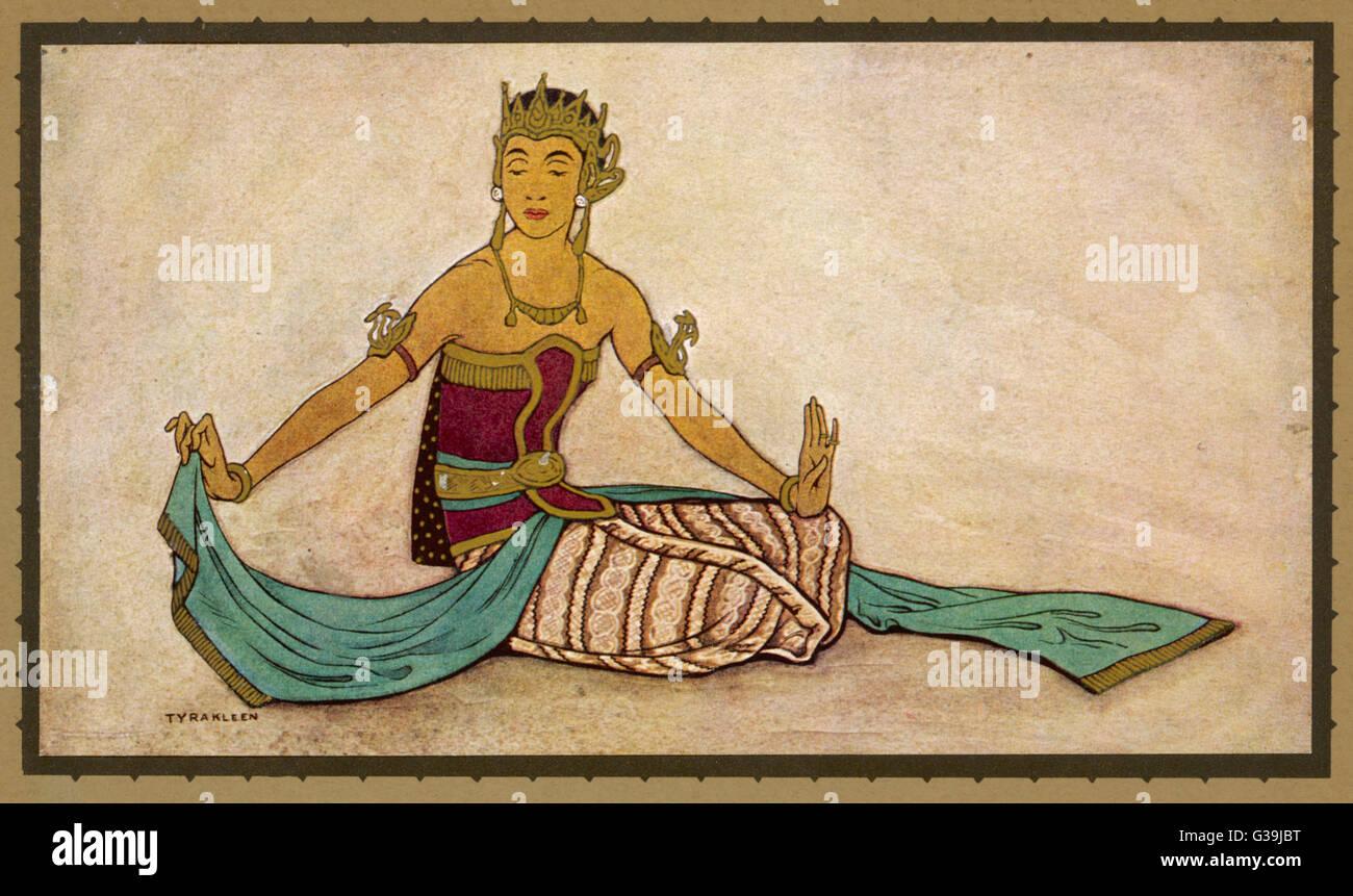 Una ballerina giavanese eseguendo la femmina stile in una posa seduto. L'uso dei polsi e sciarpa sono caratteristici Foto Stock
