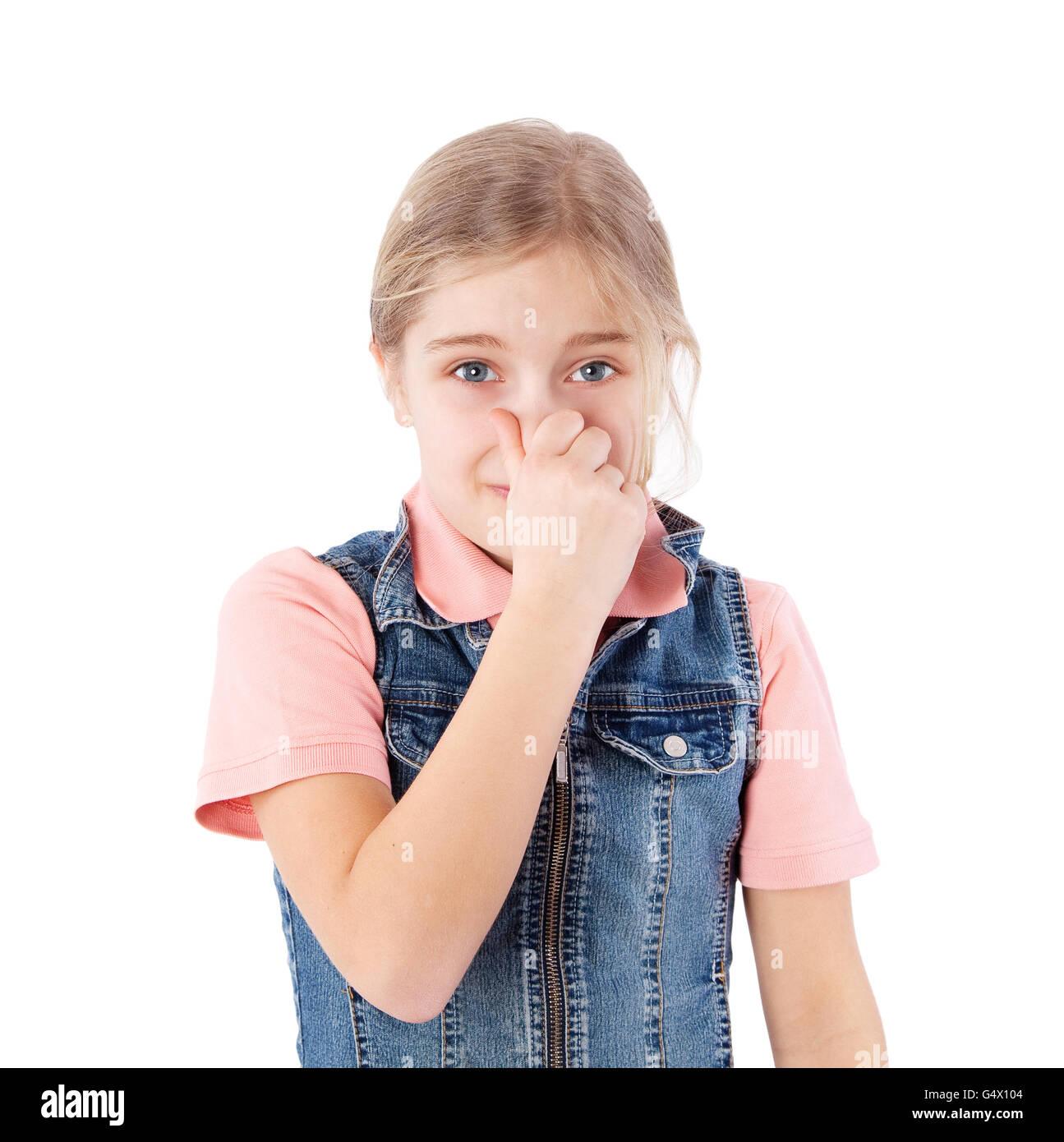 Ragazza con il suo naso a causa di un cattivo odore Immagini Stock