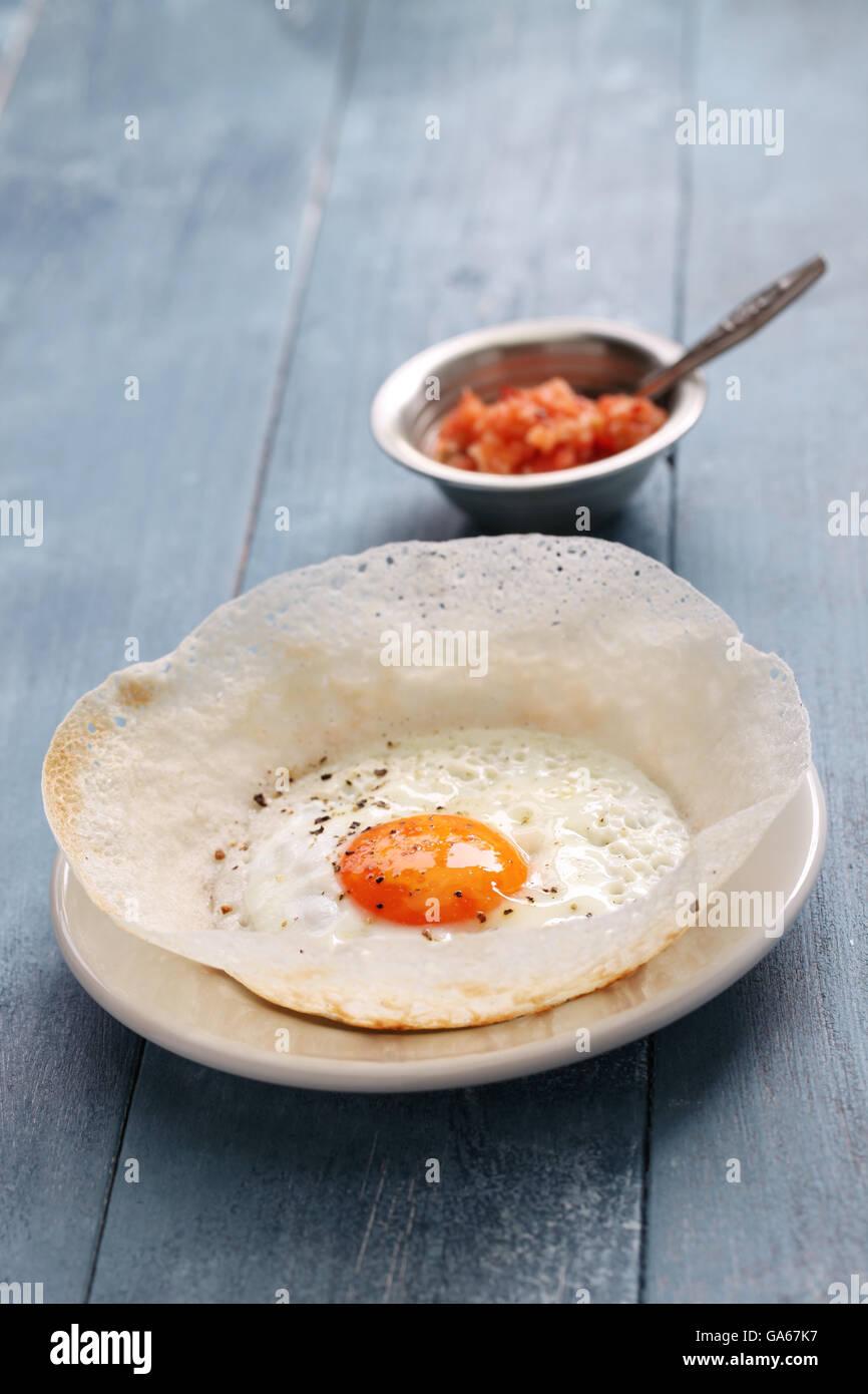 Sri Lanka tramoggia di uovo, bittara aappa Immagini Stock