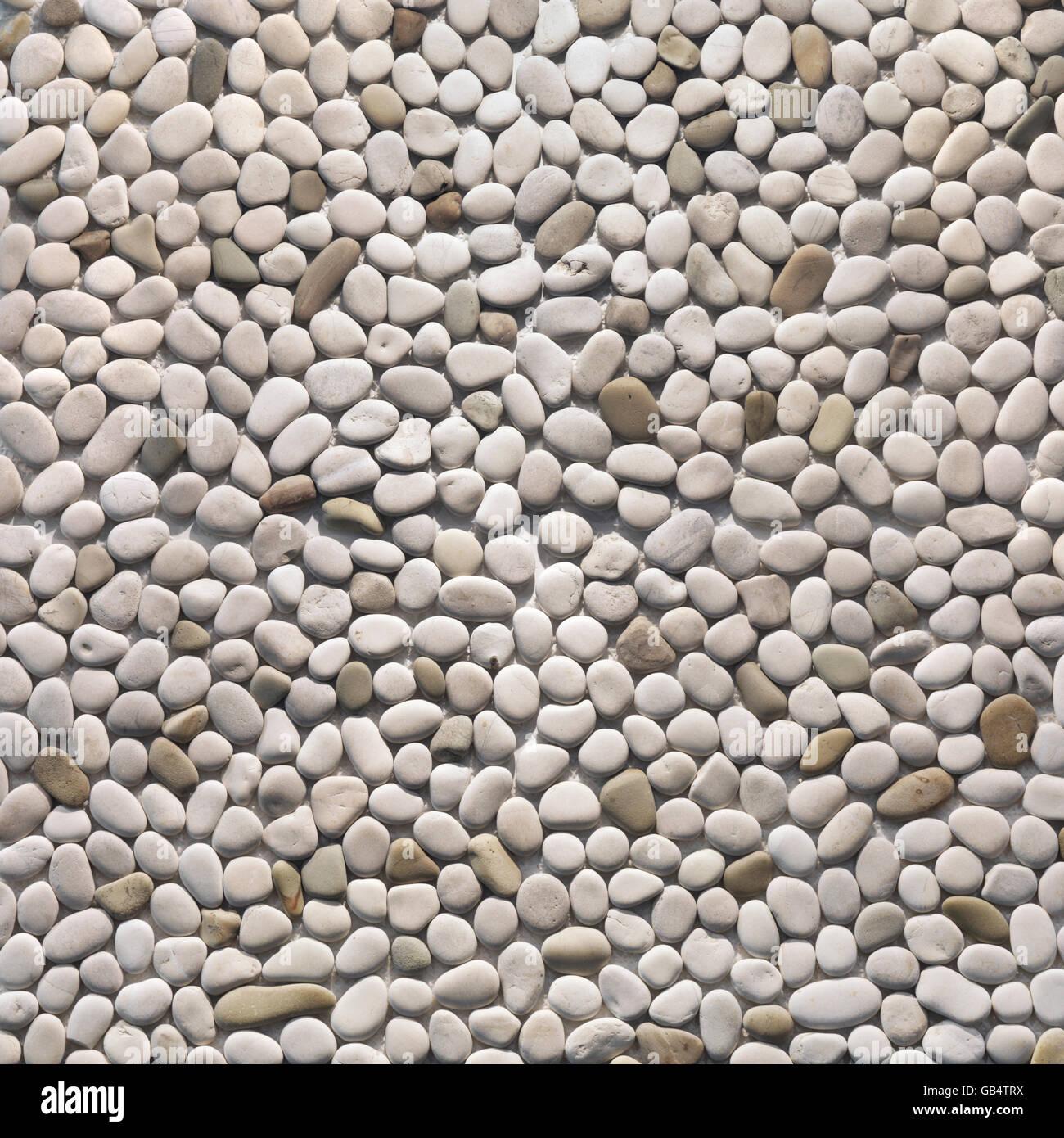Ciottoli di avorio, interni ed esterni di finitura della pietra, texture, sfondo Immagini Stock
