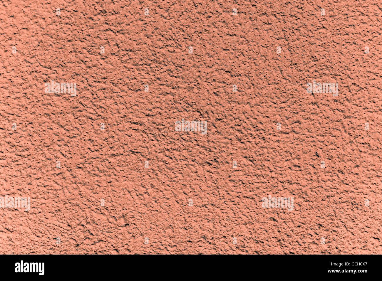 Eccellente arancione orangish grigiastro muro di pietra backgrounds - con intonaco strutturato Immagini Stock