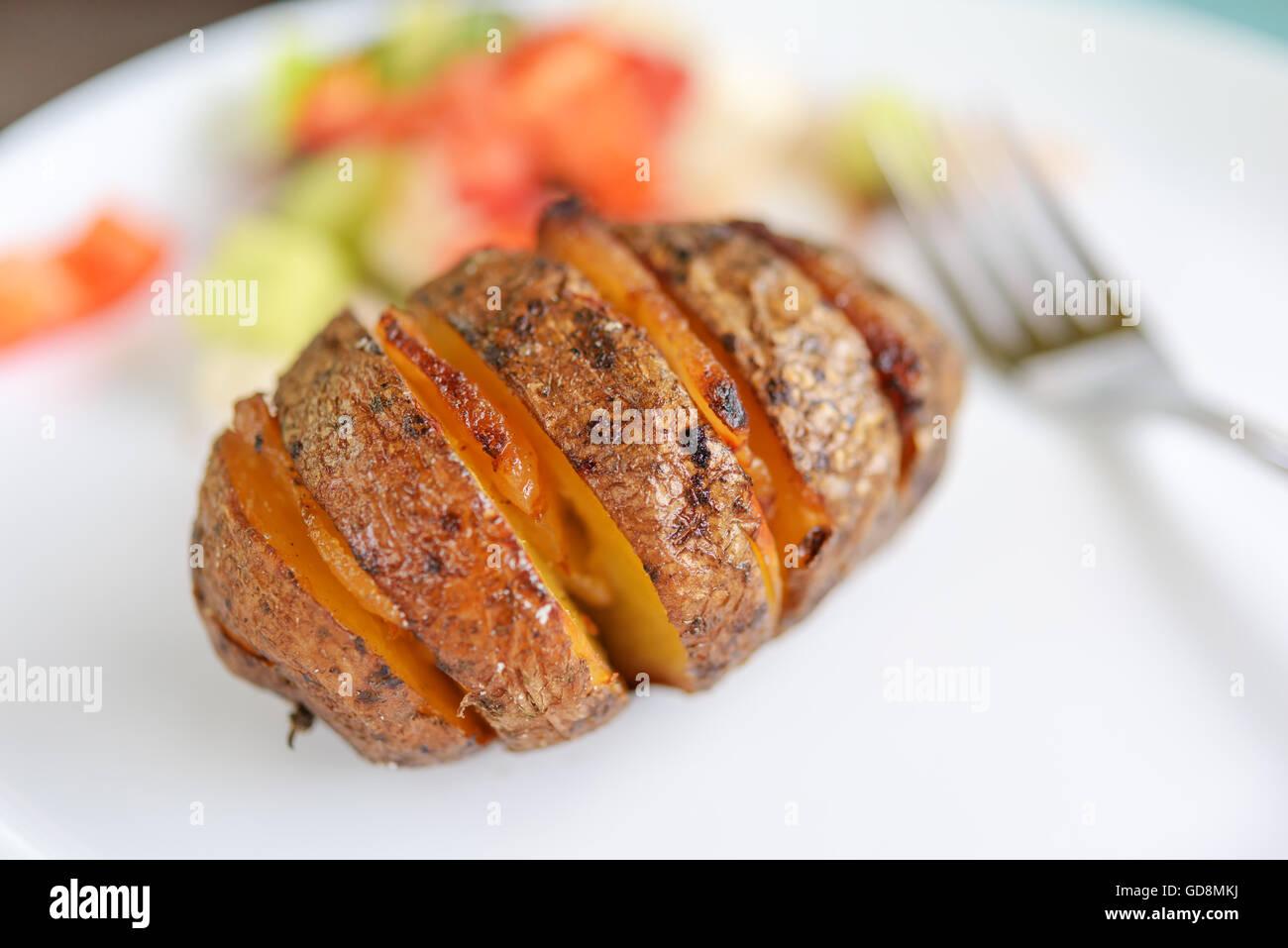 Patate al forno con pancetta closeup Immagini Stock