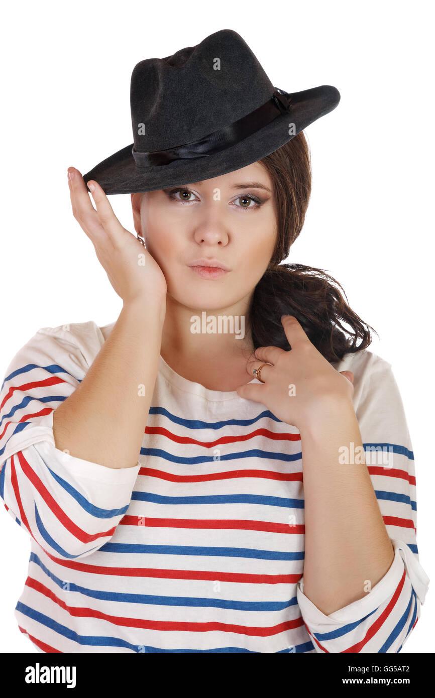 Buxomy grave ragazza con un cappello su sfondo bianco Foto Stock