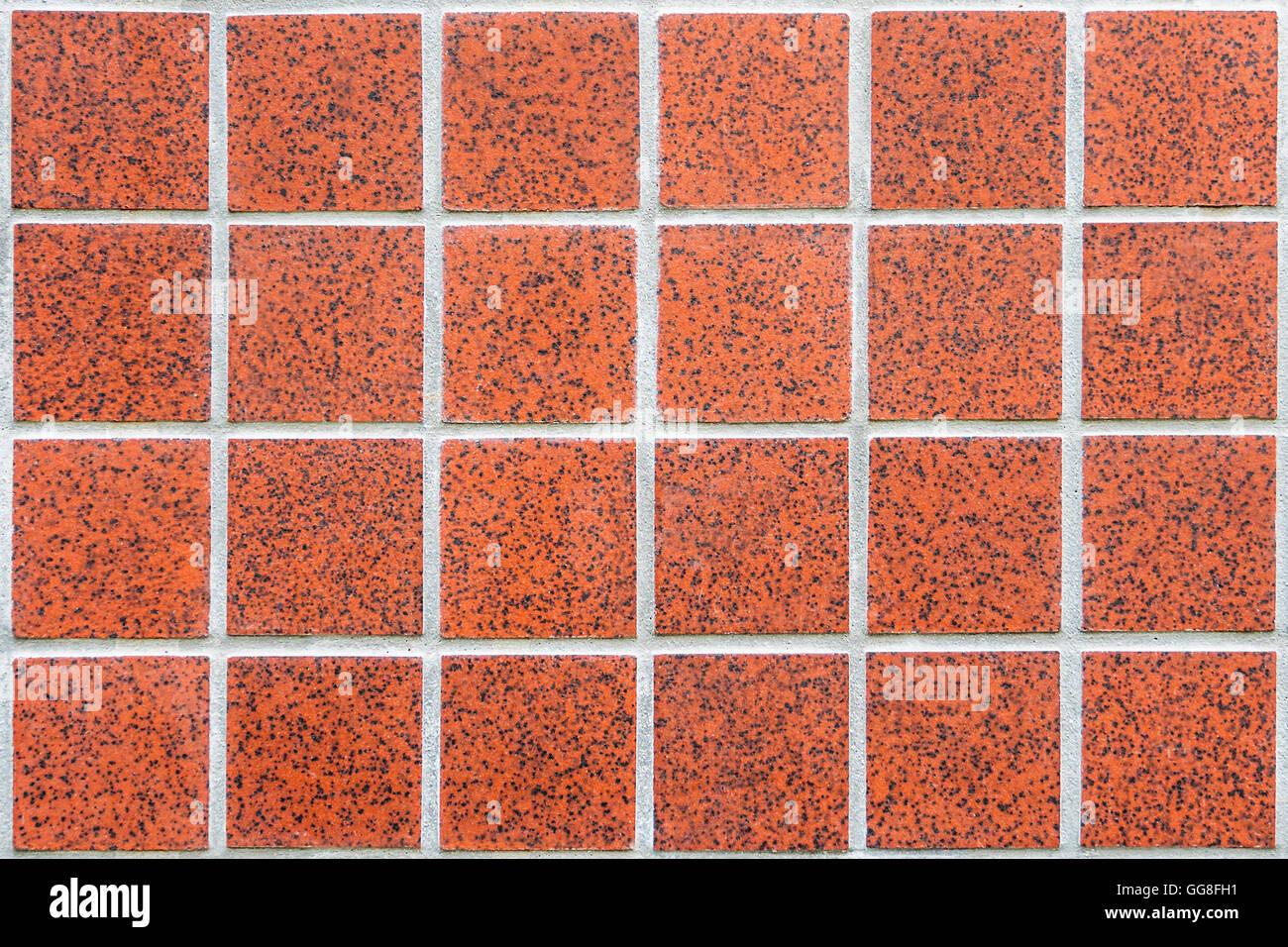 Mosaico di moderno rosso piastrelle in ceramica con piazze e bordo