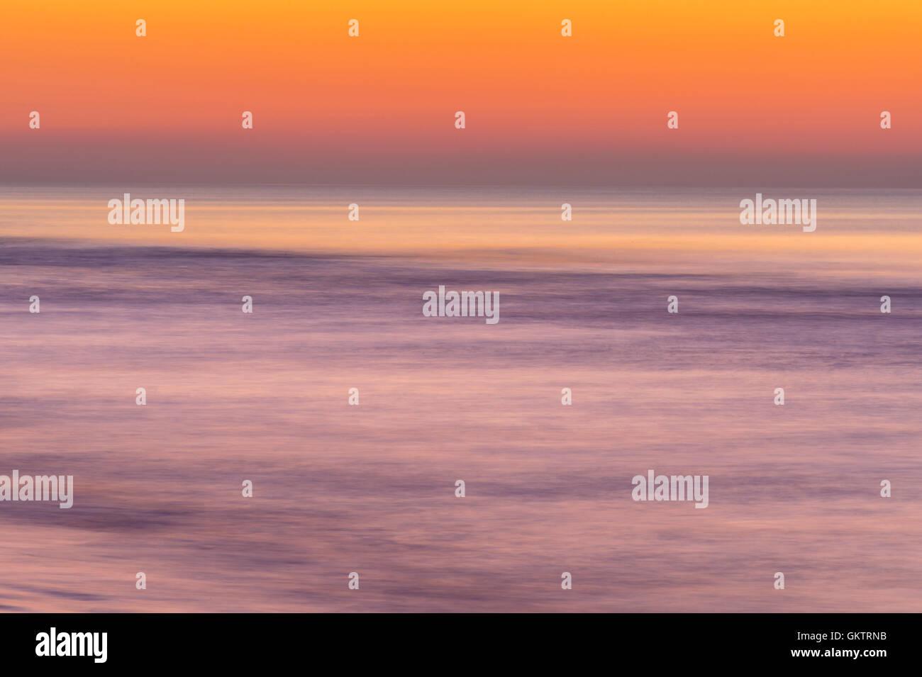 Artistico Oceano Sunrise Blur Immagini Stock