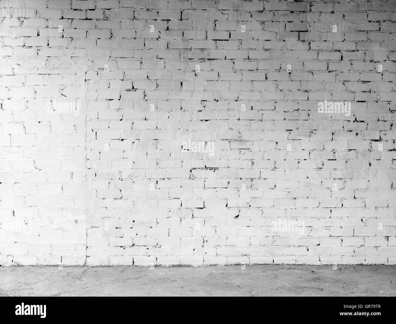 Bianco parete di mattoni per gli sfondi Grungy e la scrittura sul Immagini Stock