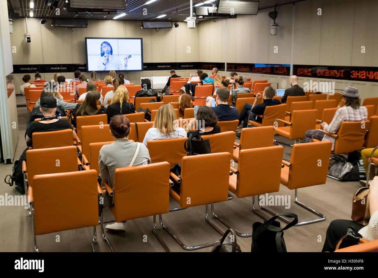 Persone partecipano a conferenze di affari Foto Stock