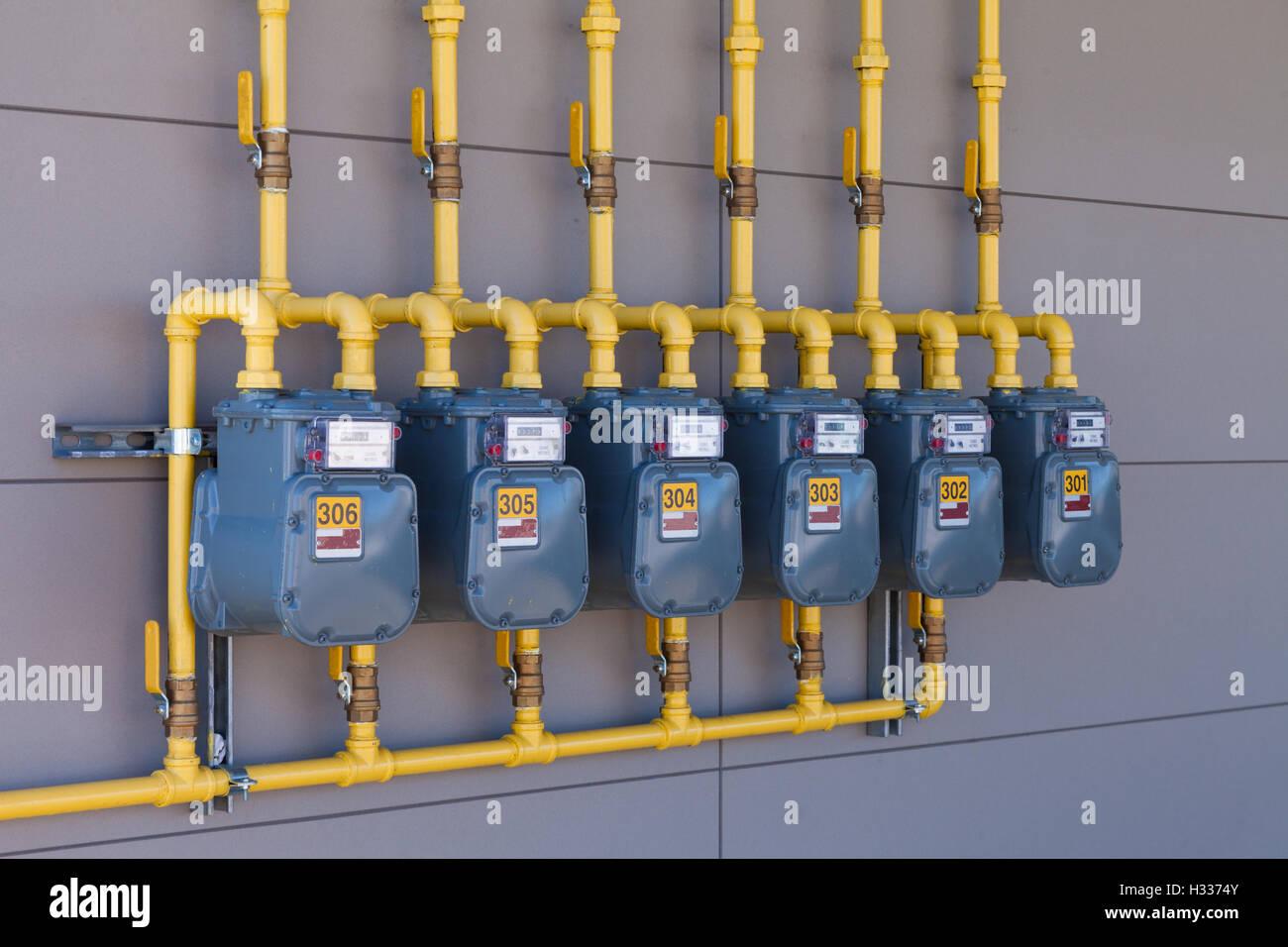 Gas residenziale metri energia fila di tubazioni di alimentazione Immagini Stock