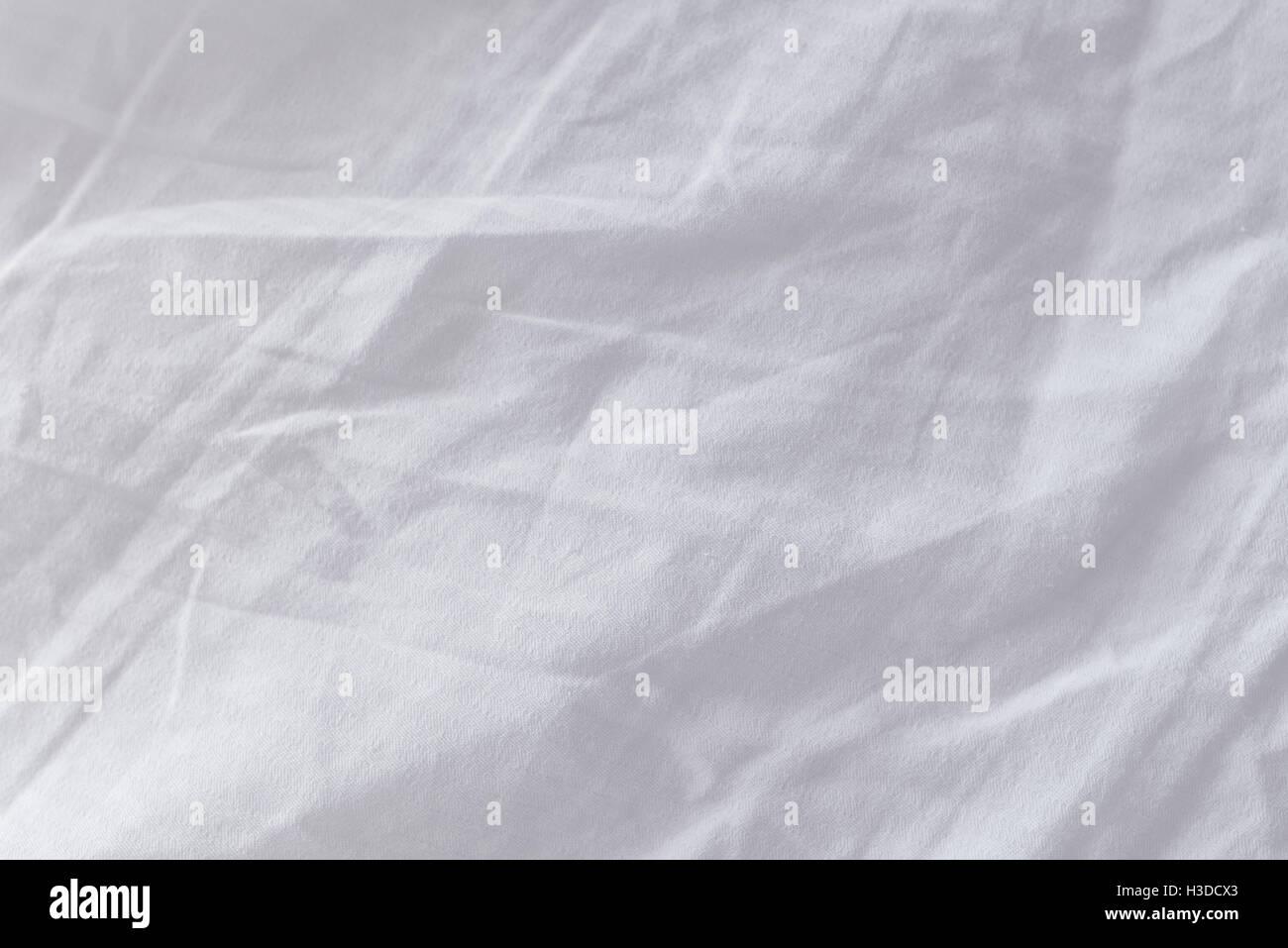 Crumpled lenzuola texture come sfondo, vista dall'alto Immagini Stock