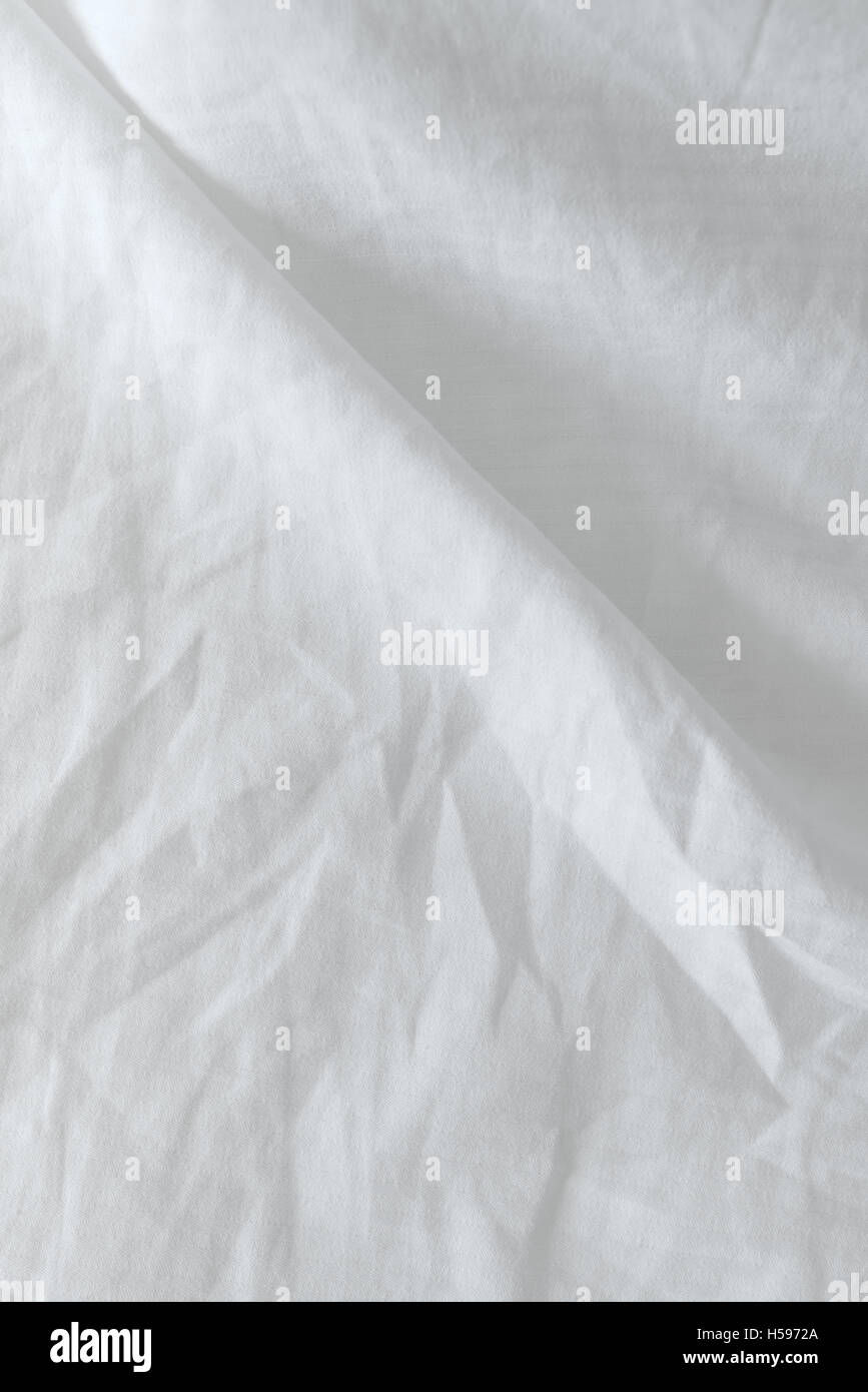Vista superiore del letto utilizzati fogli sgualciti texture di biancheria da letto Immagini Stock