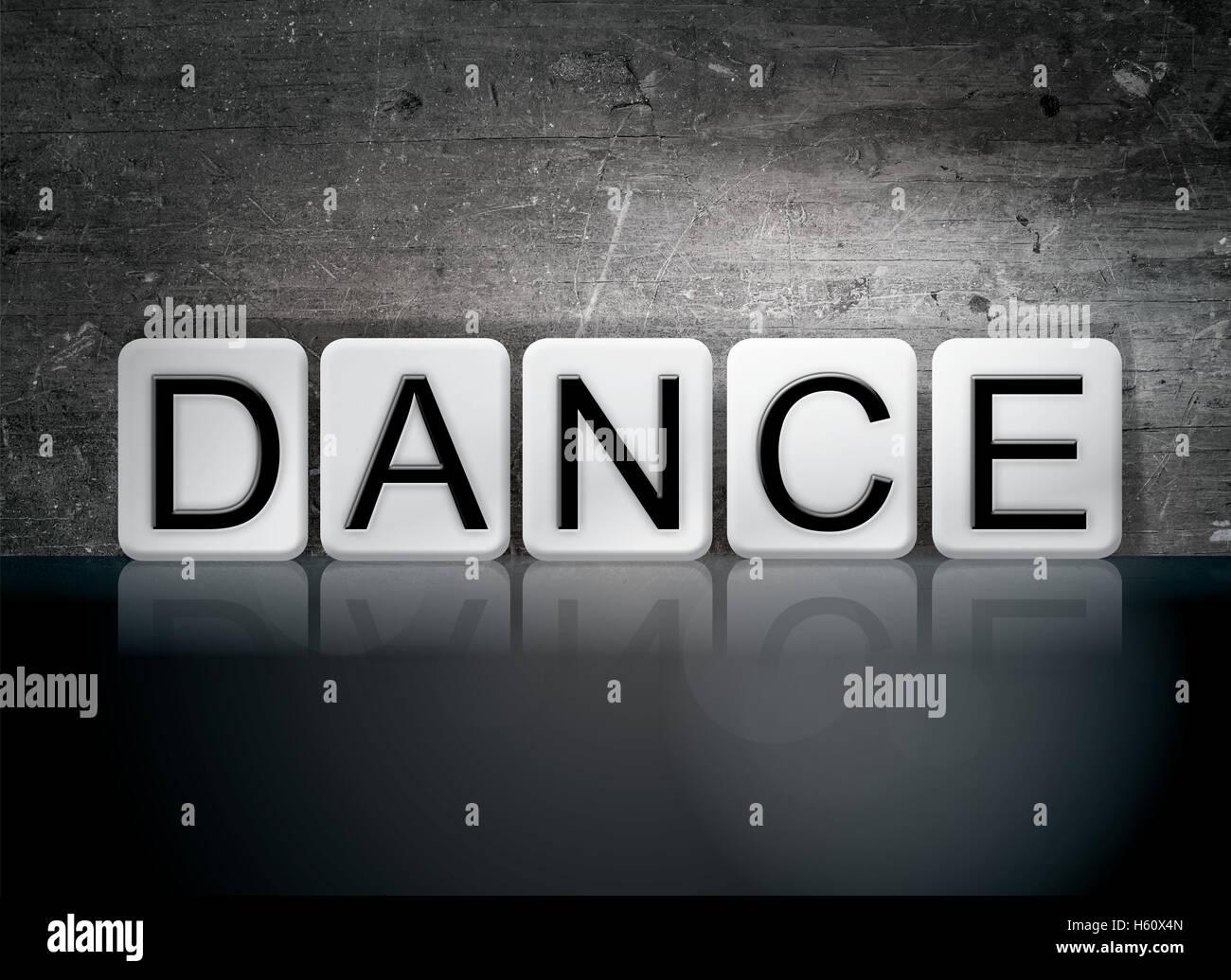 La parola danza scritto in piastrelle bianche contro un oscuro