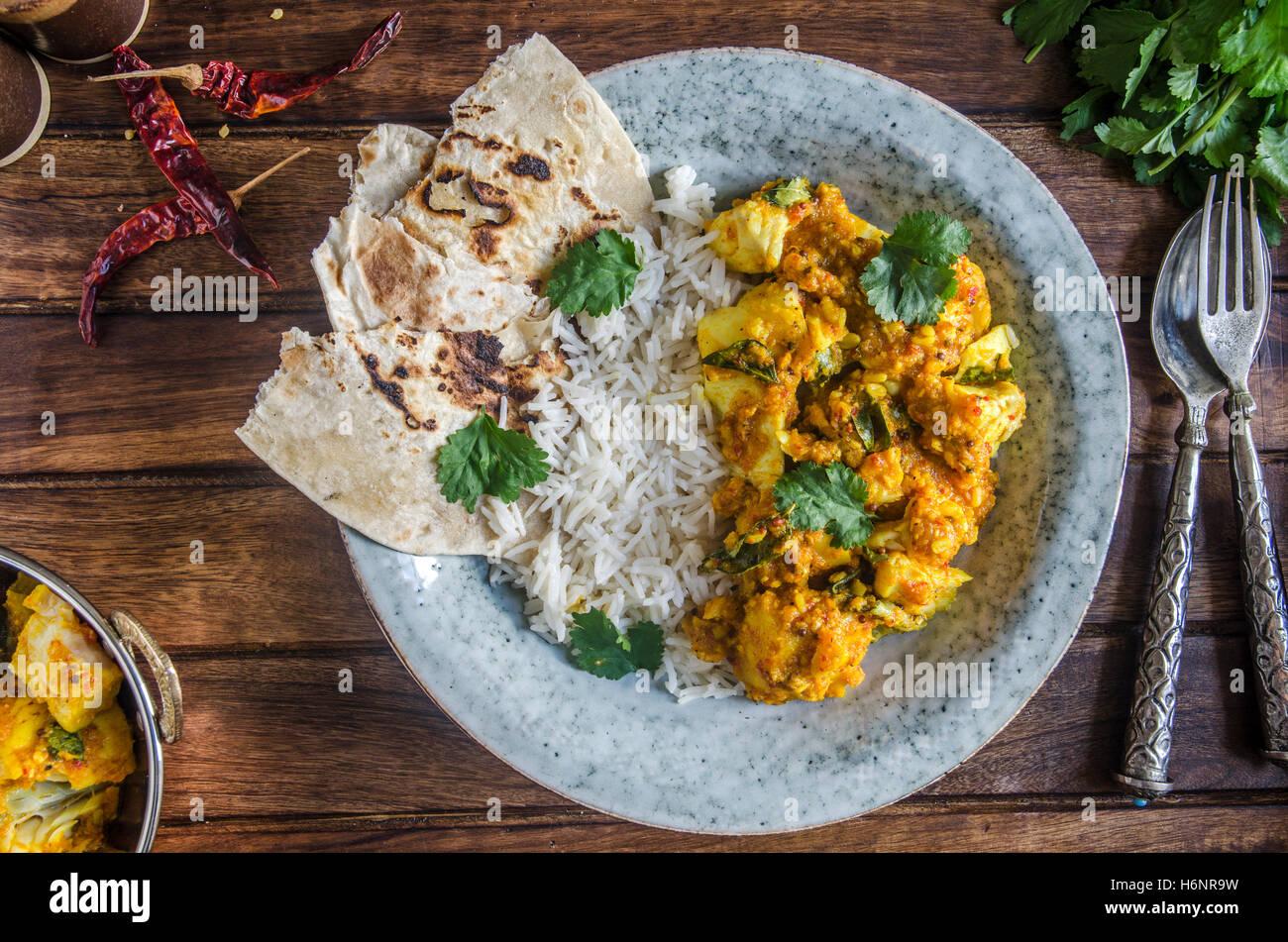 Indian cod curry con riso basmati Immagini Stock