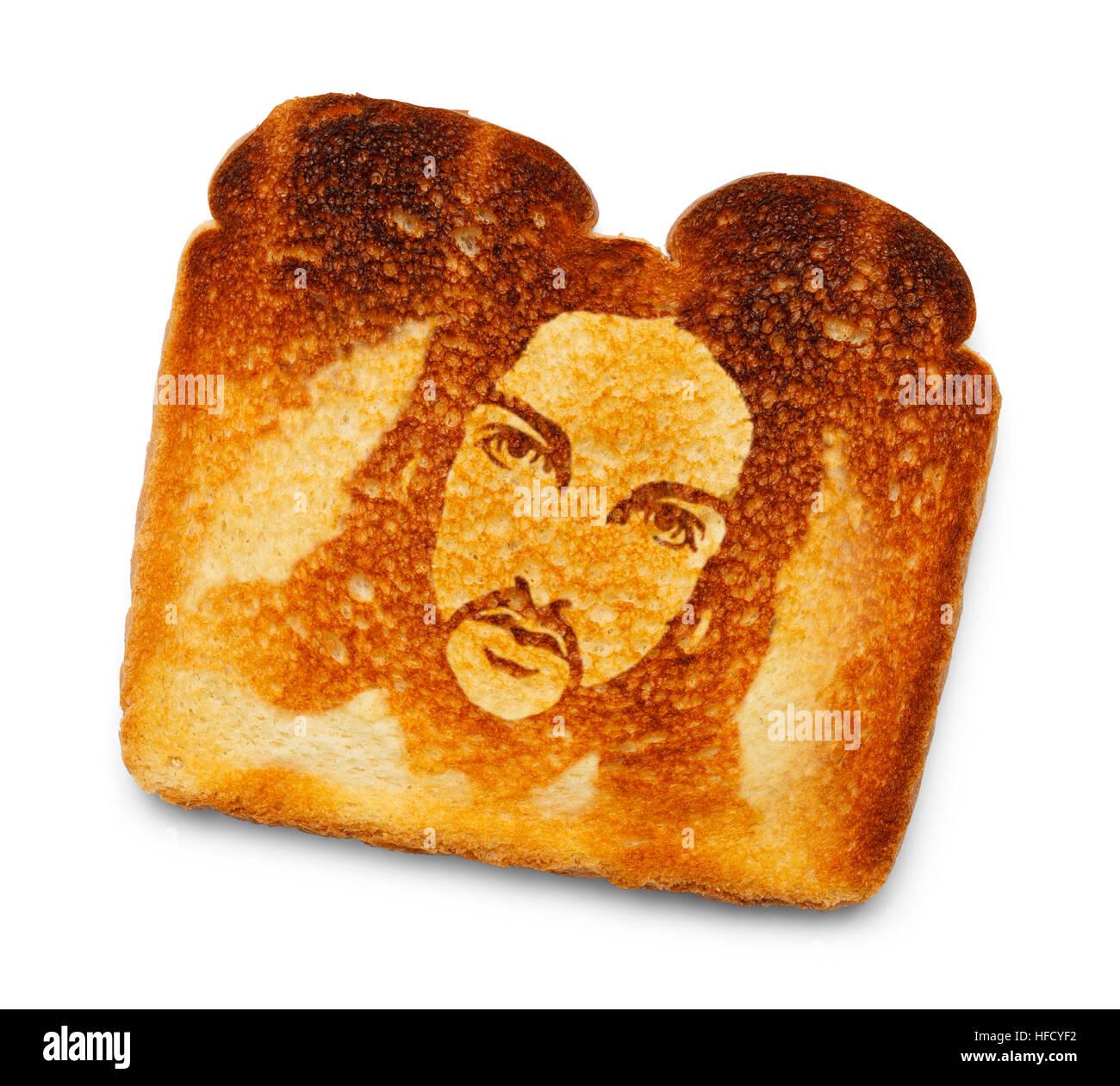 Toast bruciato con immagine di Gesù isolato su sfondo bianco. Immagini Stock